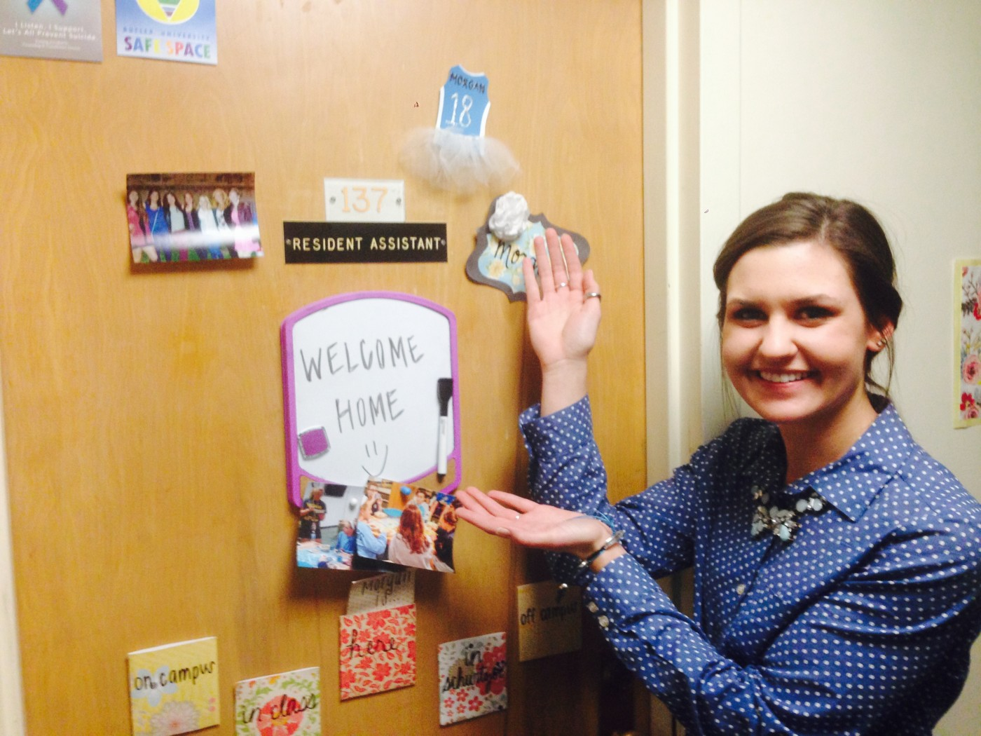 Resident Advisor showing off her decorated front door to welcome residents