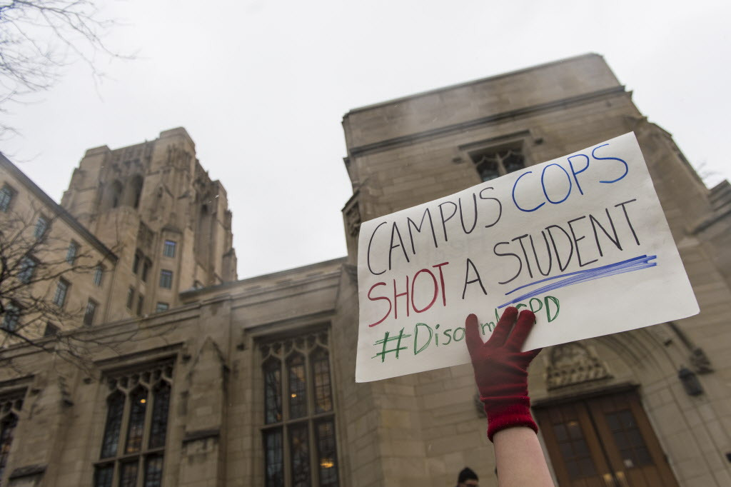 University of Chicago Student Brandishing Stake Pole Shot by Campus Police