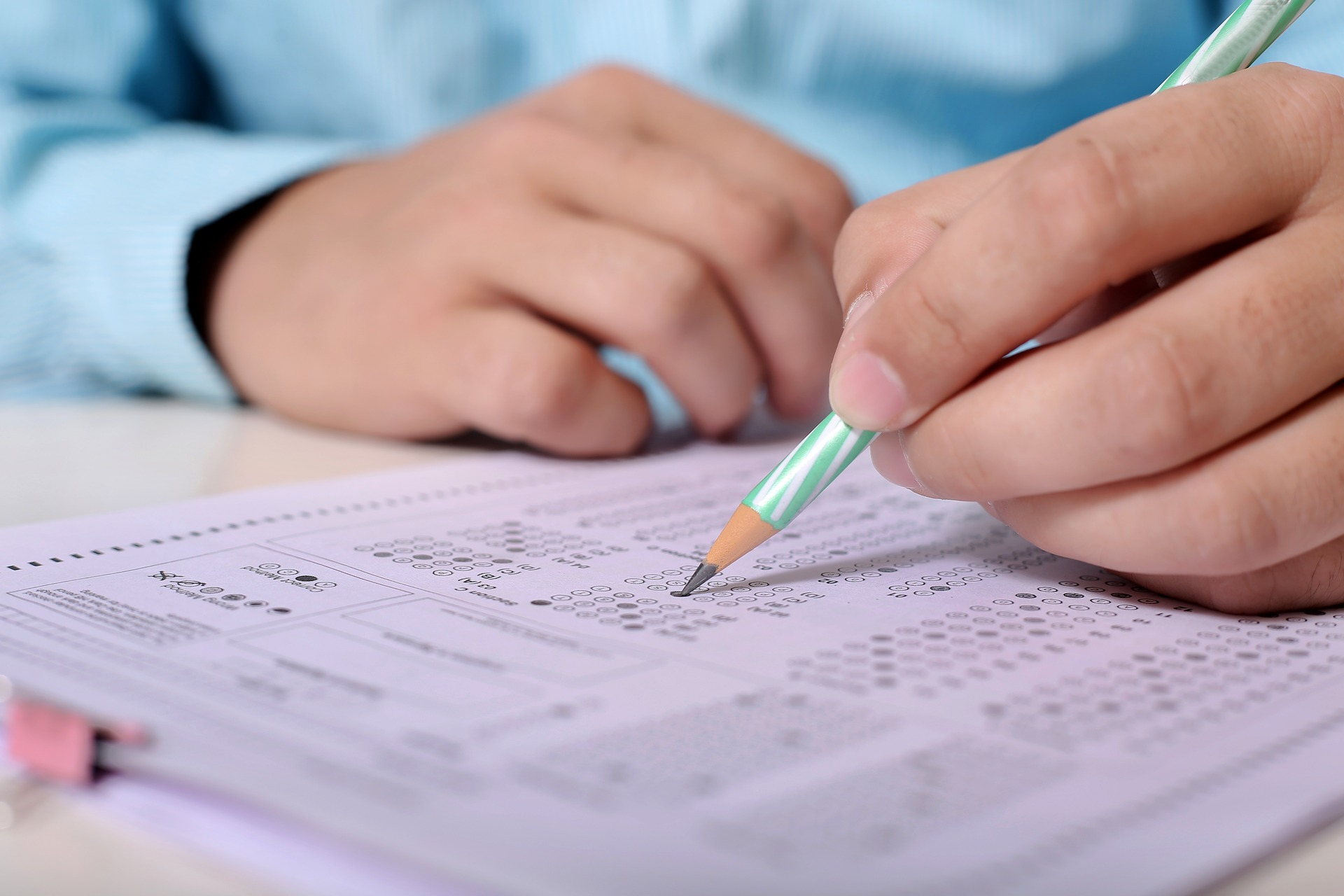 student taking a scantron exam in school