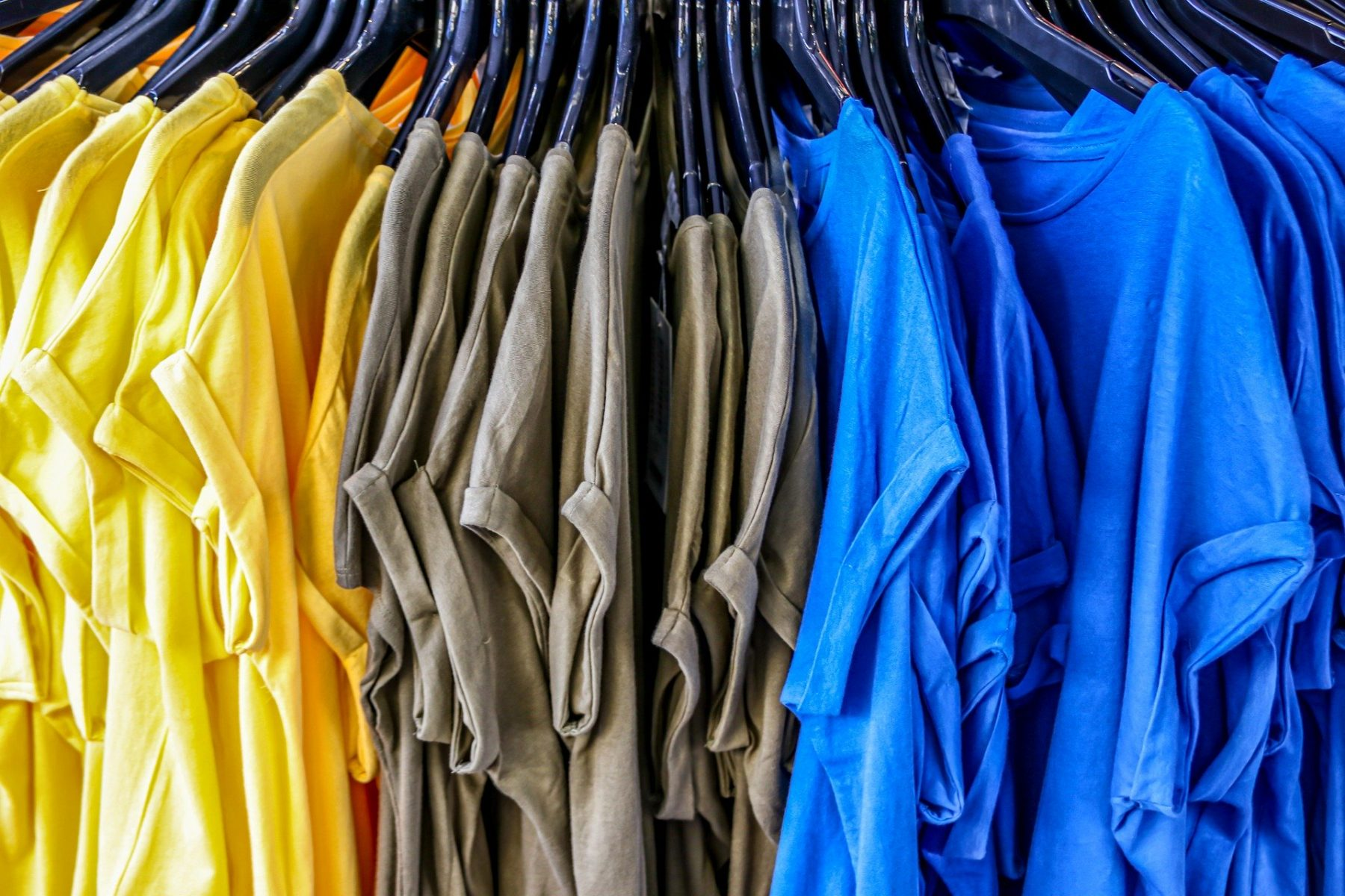 picture of t-shirts on a sales rack in an article about DIY projects you can do with them