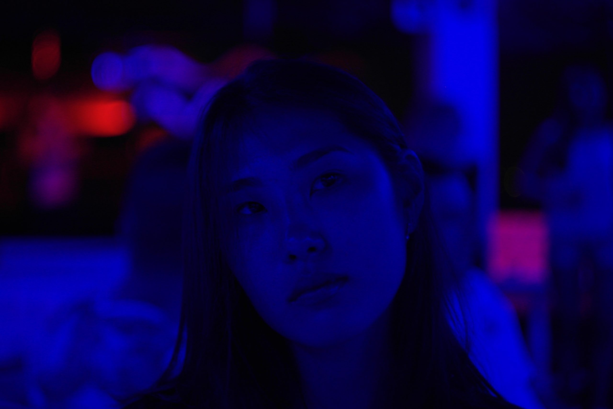Describing stigma surrounding Asian-American women, many of these women can be left in the dark when it comes to body positivity in a tug-of-war between their two cultures much like the woman pictured above in a dark scene with little light.
