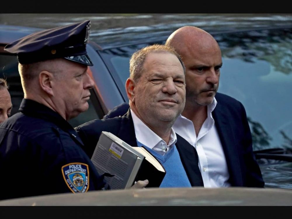 Harvey Weinstein escorted by police officer in article about events other than COVID-19 that took place in March