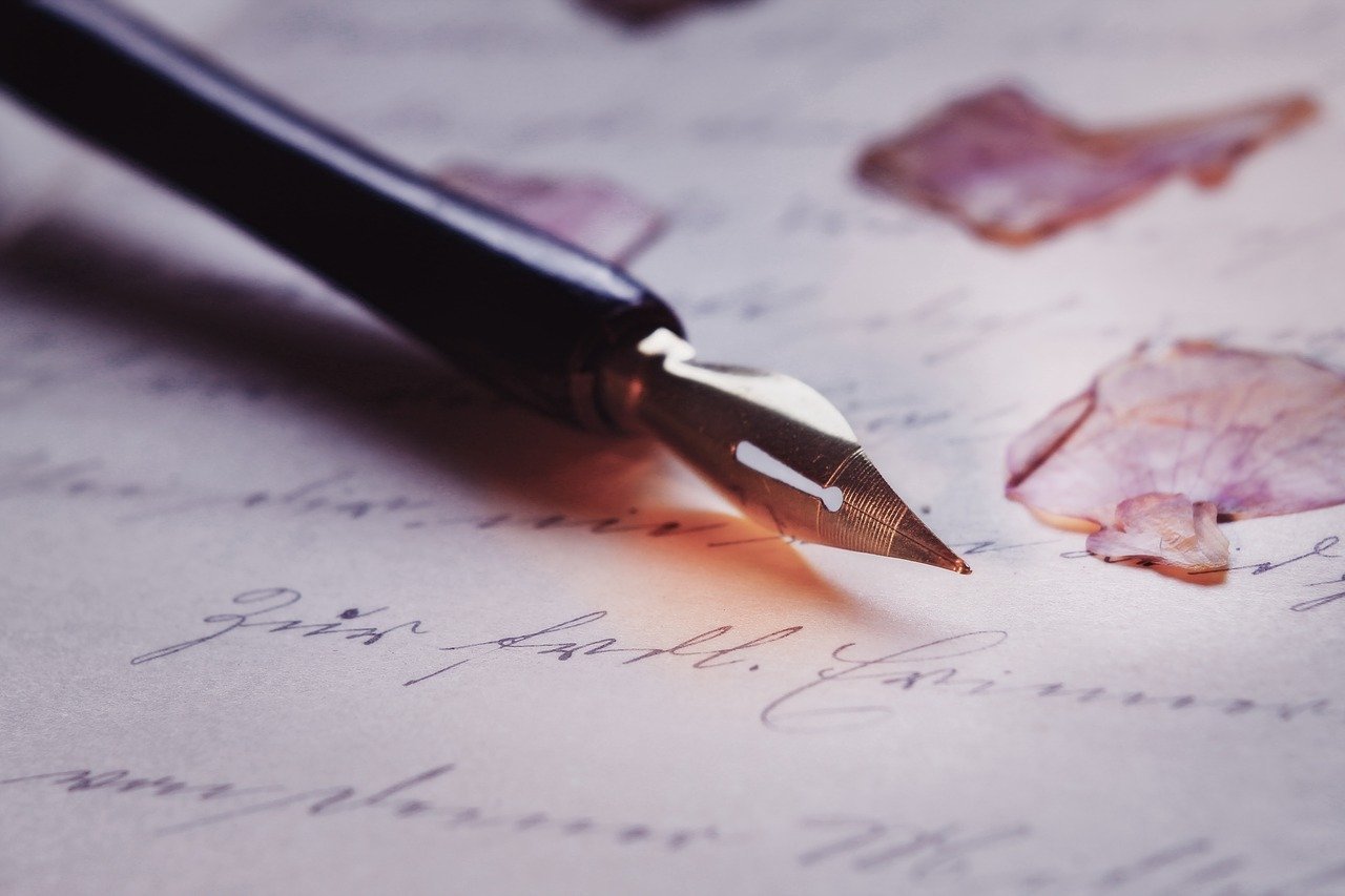 a pen used for writing on a letter