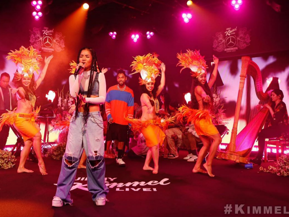 In an article describing her latest album, Jhené Aiko is seen here performing on 'Saturday Night Live with Jimmy Kimmel'