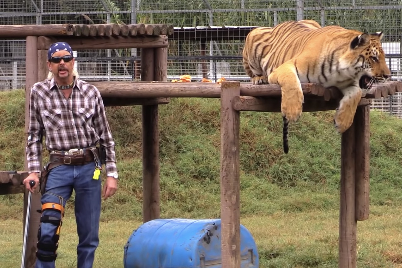 The Tiger King, Joe Exotic, with a tiger