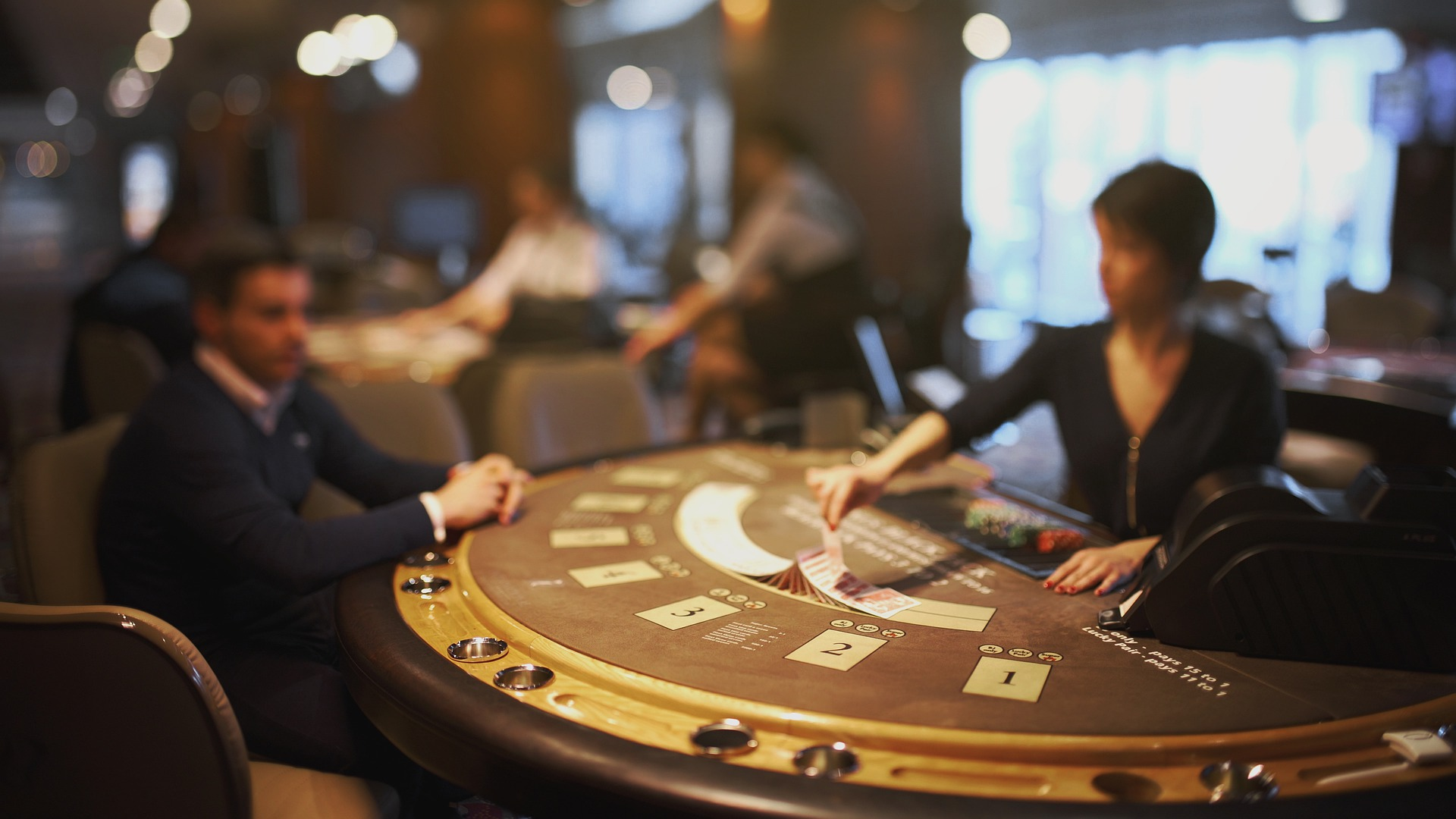 Man at blackjack table in article about no deposit bonuses
