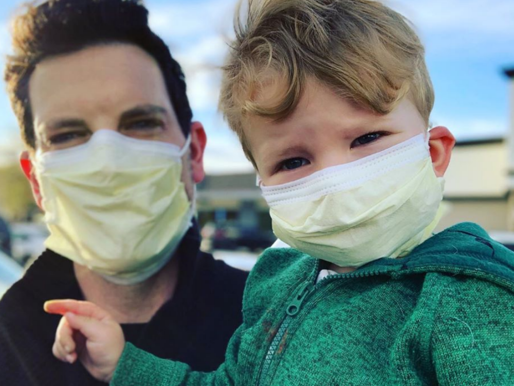 Chris Mann, pictured above with his son, has taken his musical capabilities to create parodies of famous songs to highlight the anxiety and boredom brought on by COVID-19.