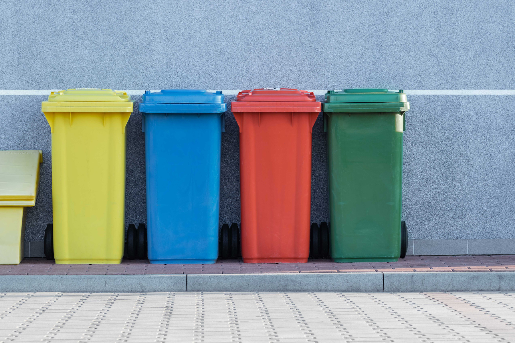 four recycling bins in an article about sustainability
