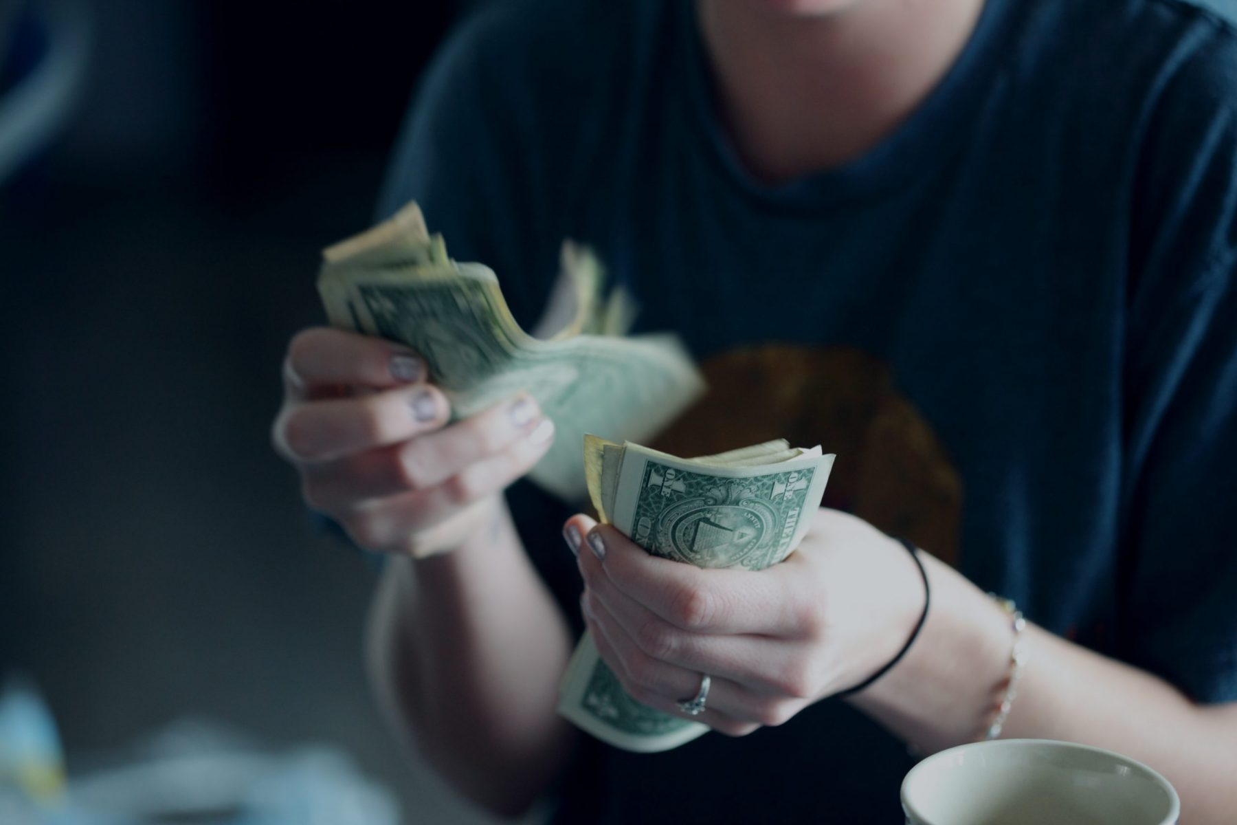 College student counting money
