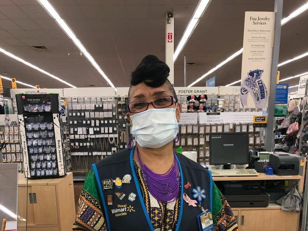 retail worker in one of many essential businesses wearing a mask