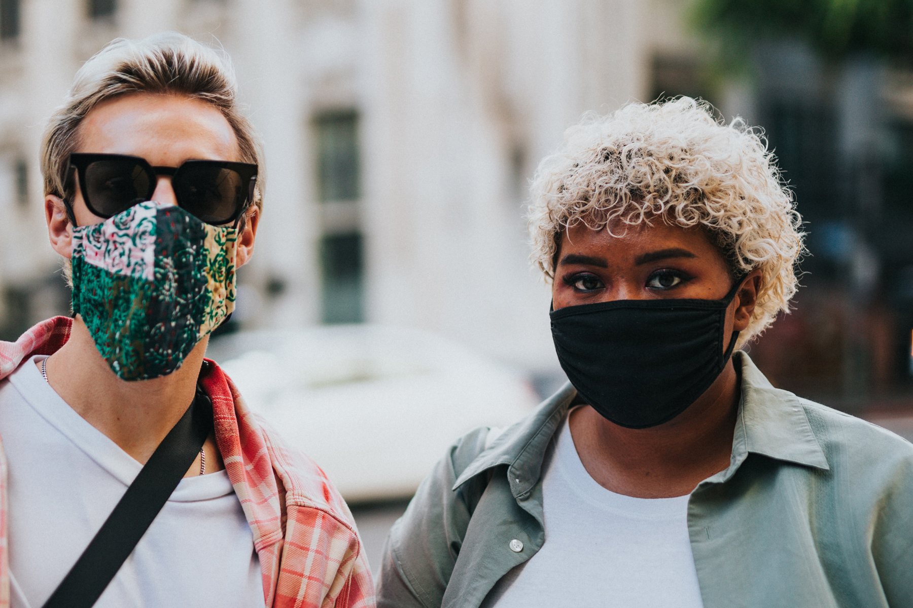 In an article about COVID-19 mourning, two people in face masks