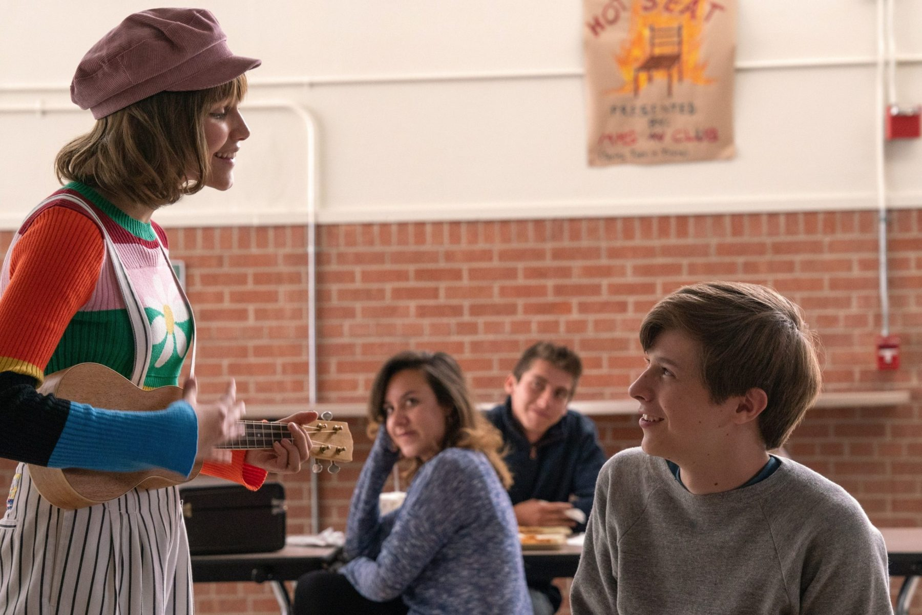 A scene from 'Stargirl' where Stargirl sings to Leo in the school cafeteria