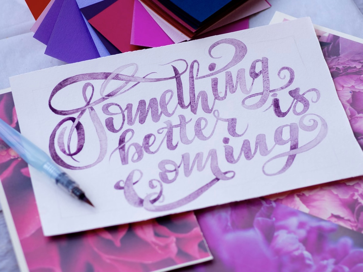 "Photo of a card from Unsplash that says ""Something better is coming"" in article about TikTok's manifestation trend"