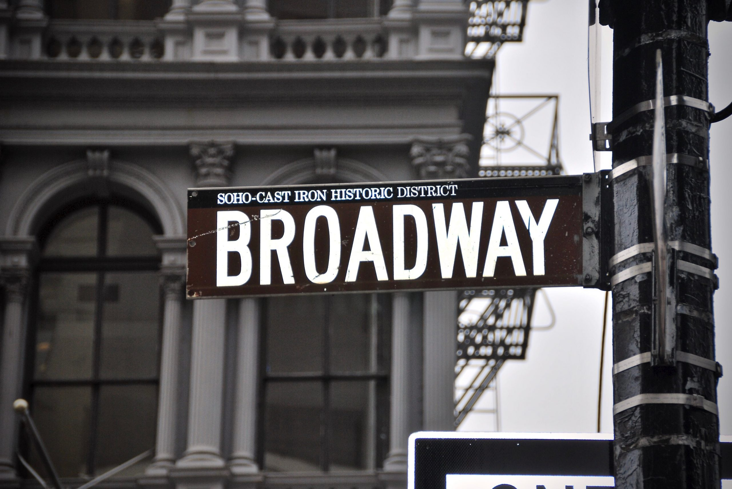 A brown Broadway sign leads the way to the Antonyos.