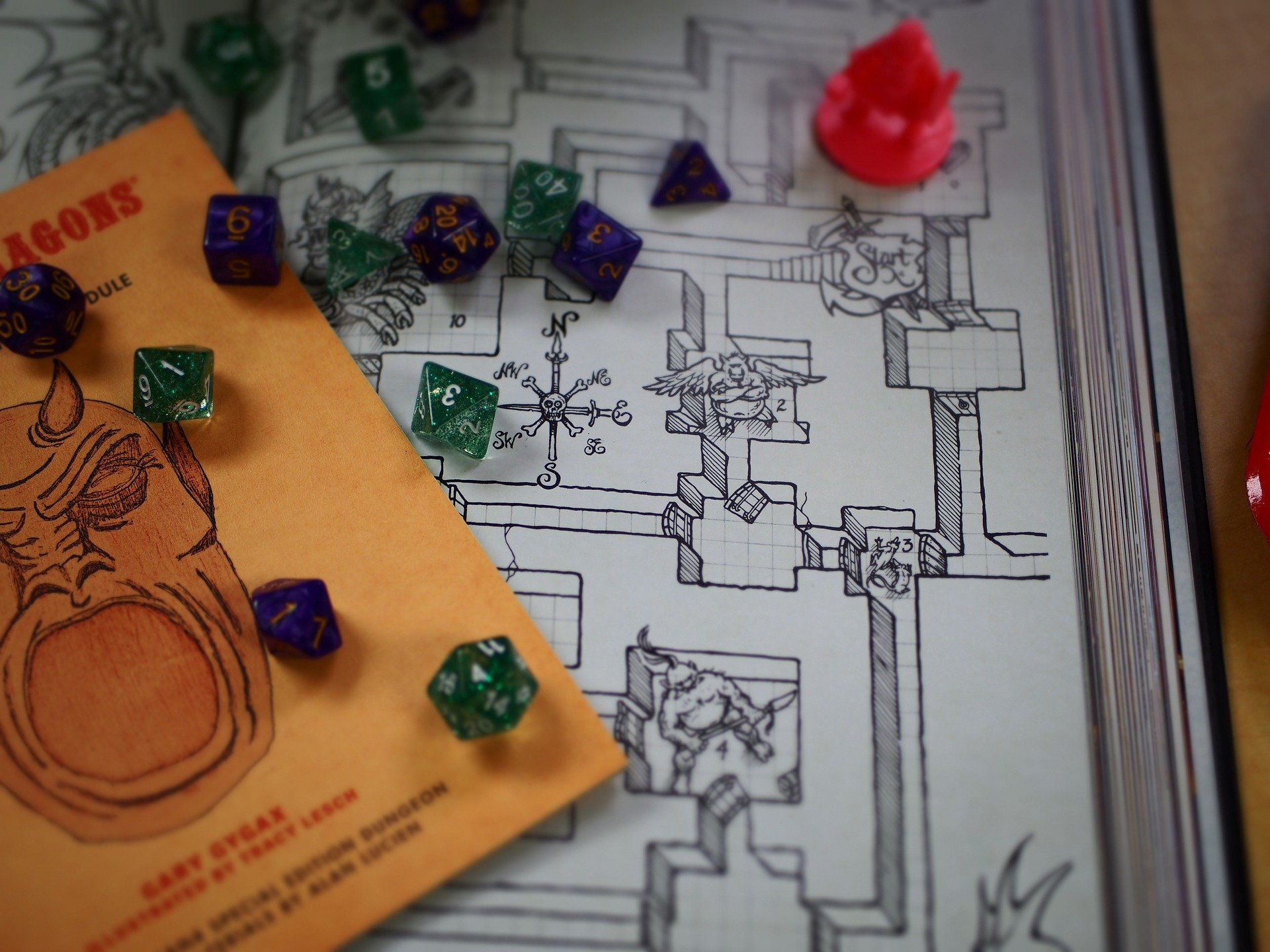 Tabletop role-playing games illustrated by Dungeons and Dragons dice and board.