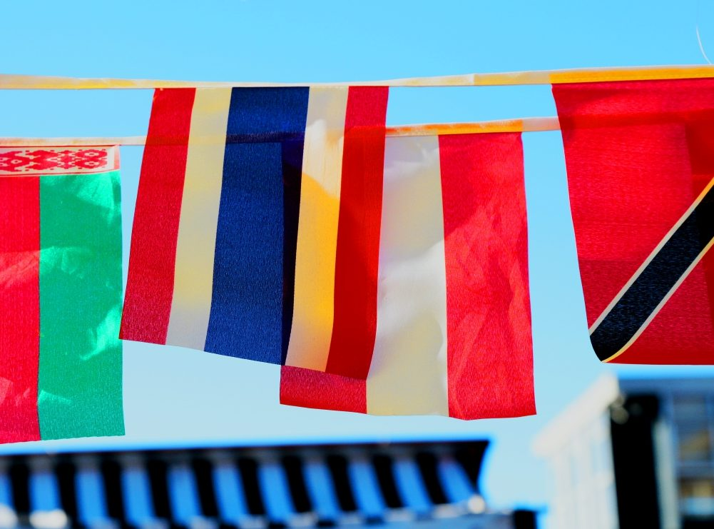 Photo of flags from Unsplash in article about ICE wanting to deport international students