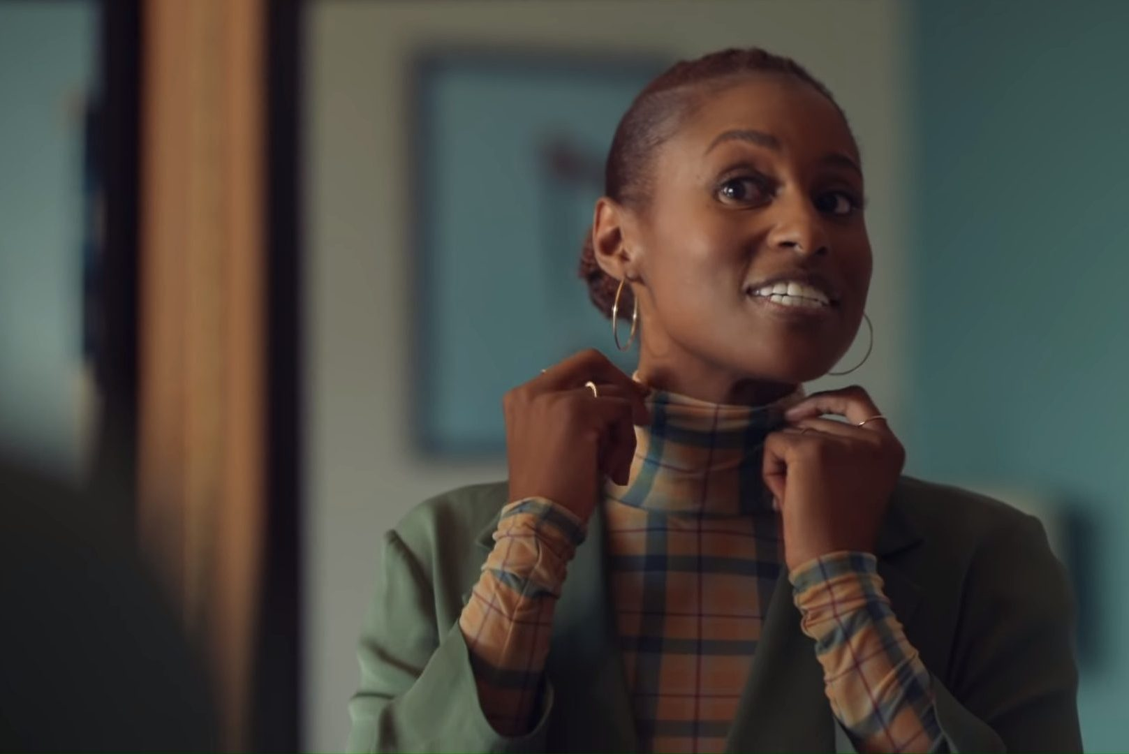 Issa Rae, one of many black writers, adjusts her outfit in 'Insecure.'