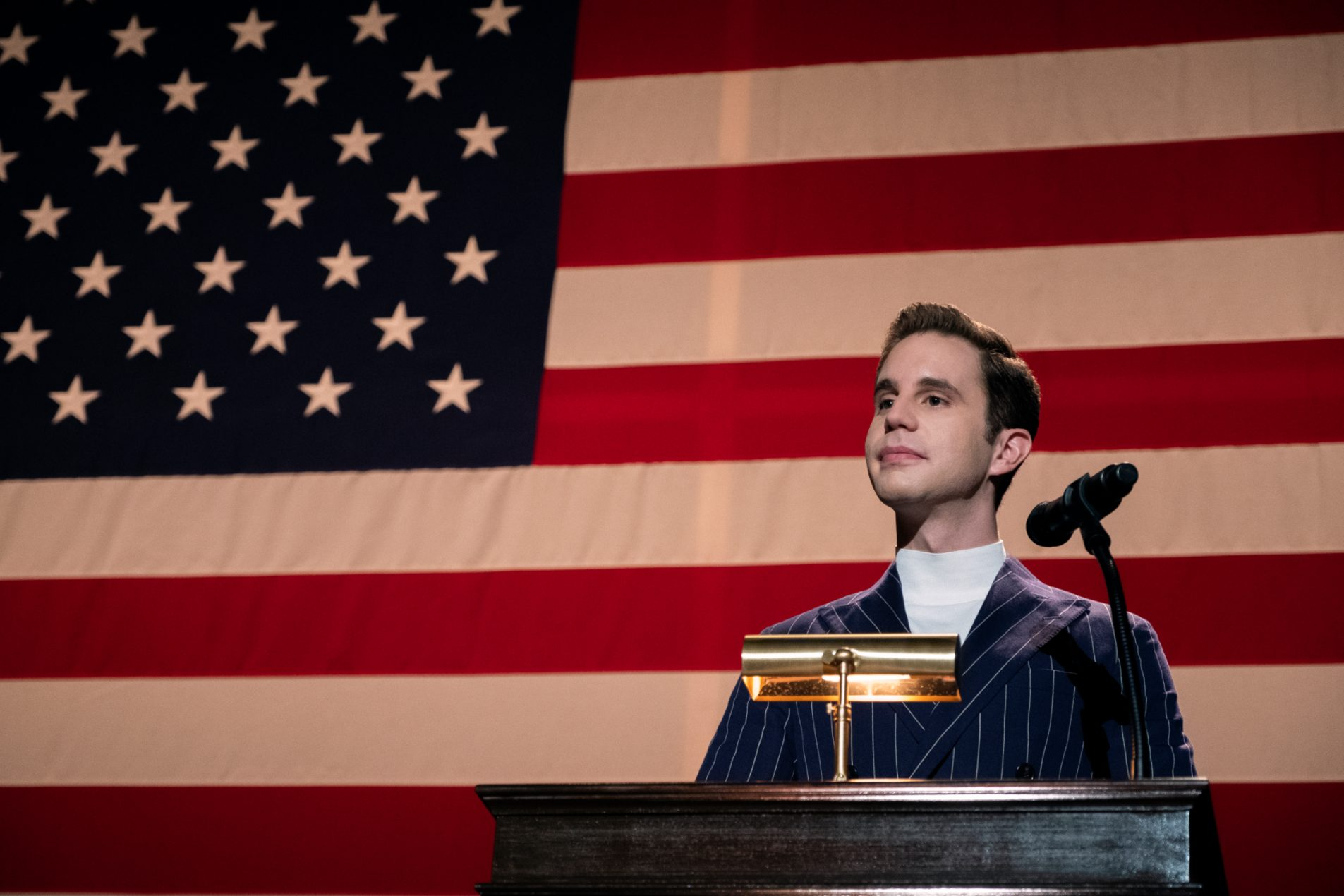 Ben Platt as Payton Hobart gives a political speech in front of the American flag in The Politician.