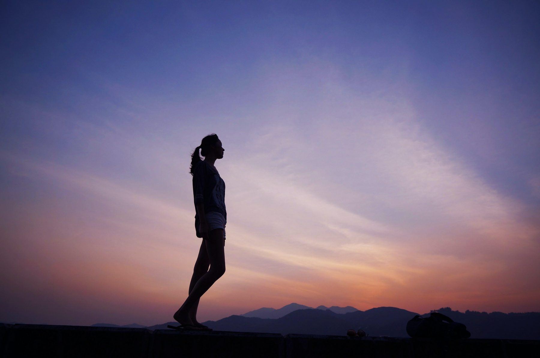 in article about working out when you have disordered behaviors, photo of person silhouetted against sunset