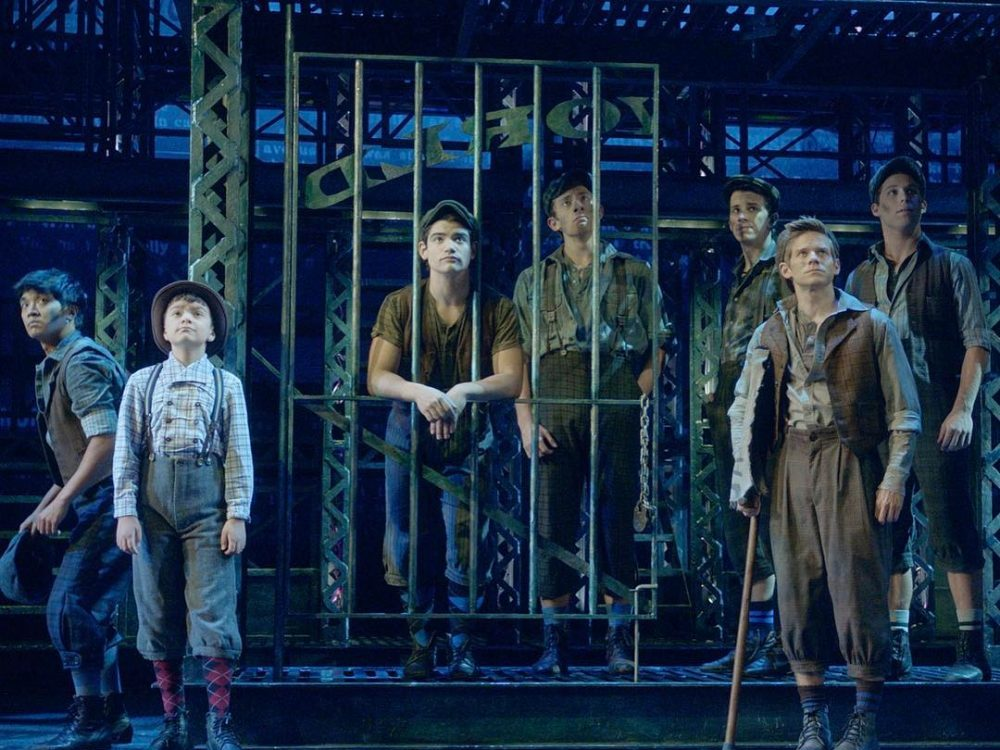 In an article about what to watch after Hamilton, a picture of a production of Newsies