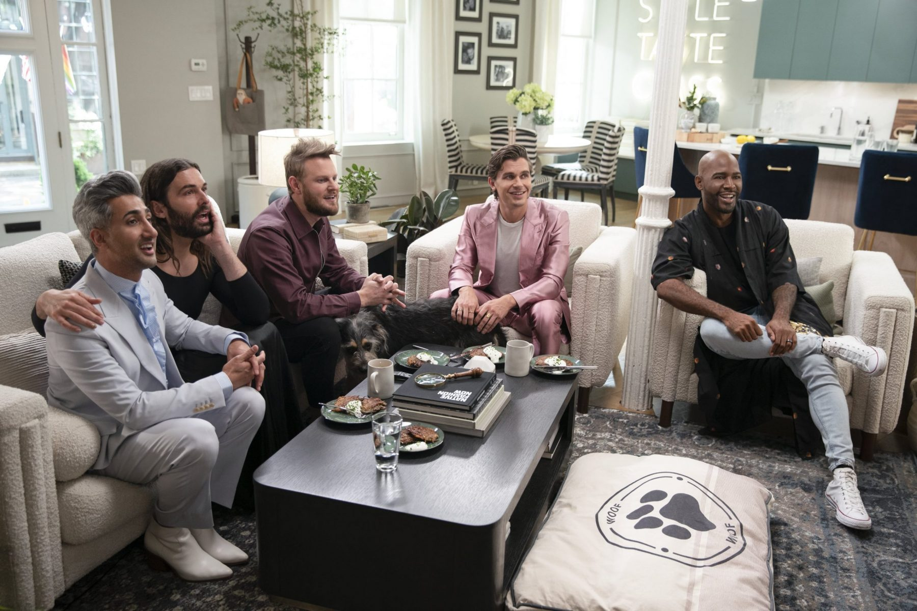 The Fab Five of Queer Eye sit on couches together