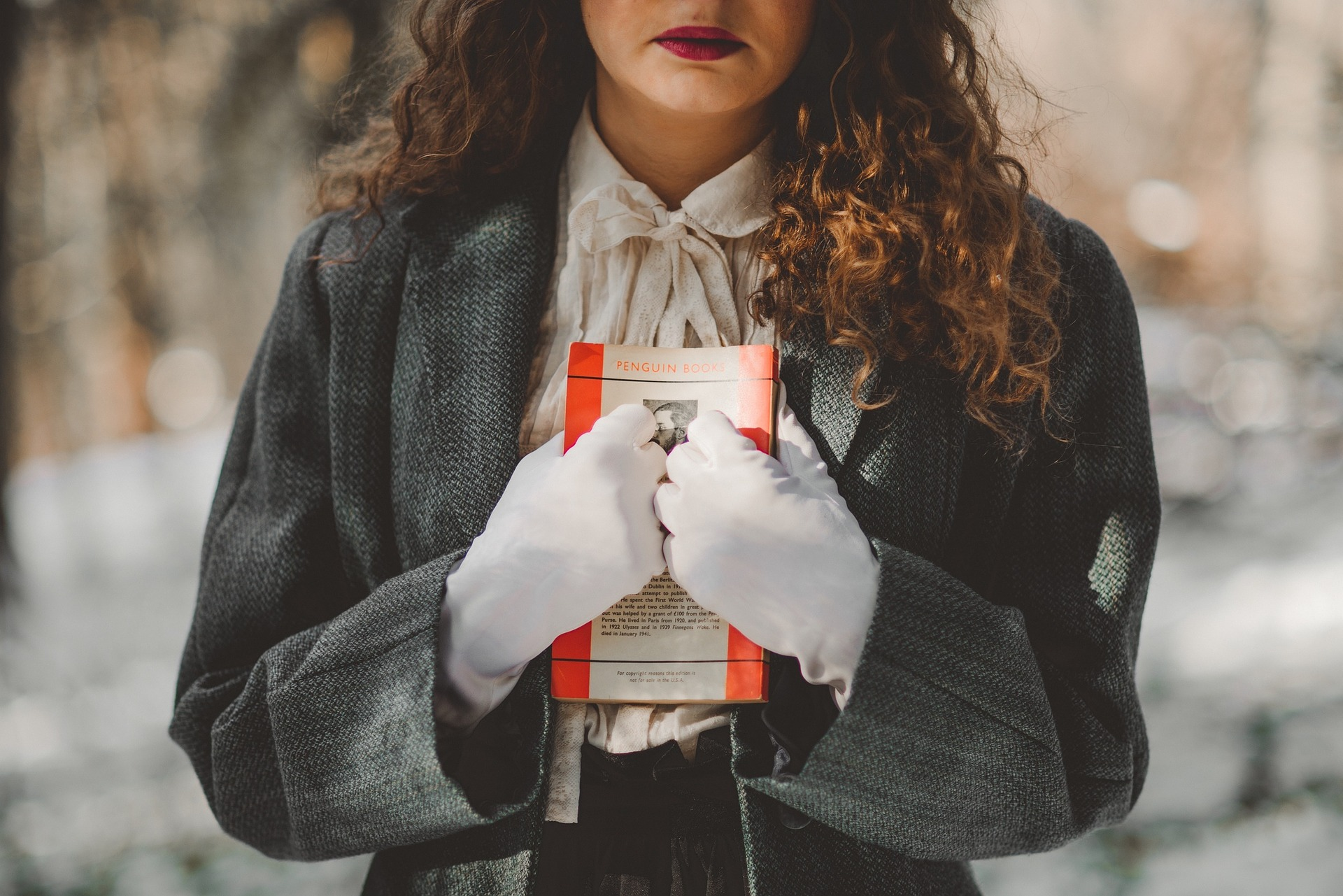 In an article about whether to finish a book you hate reading, an image of a woman clutching a book