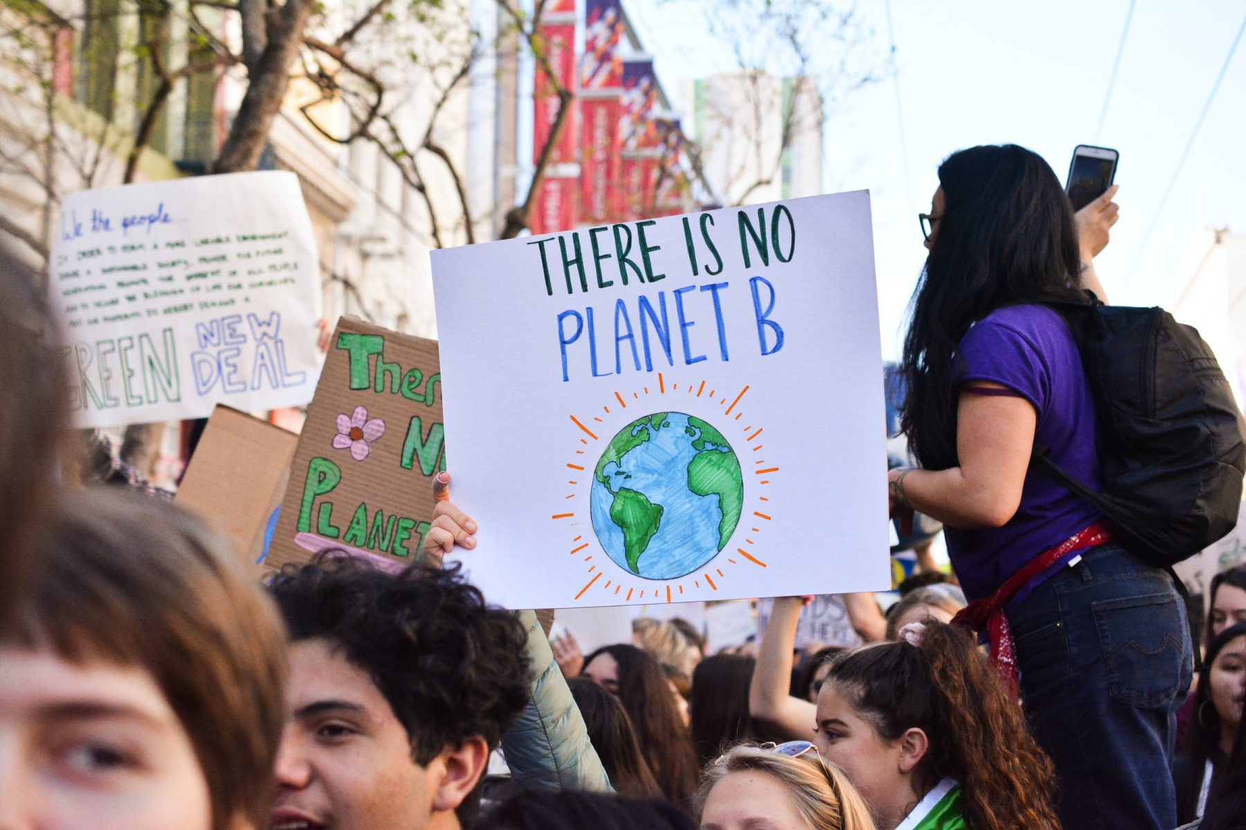 "In an article about Joe Biden and the climate crisis, a photo of protesters and a sign reading, ""There is no Planet B."""