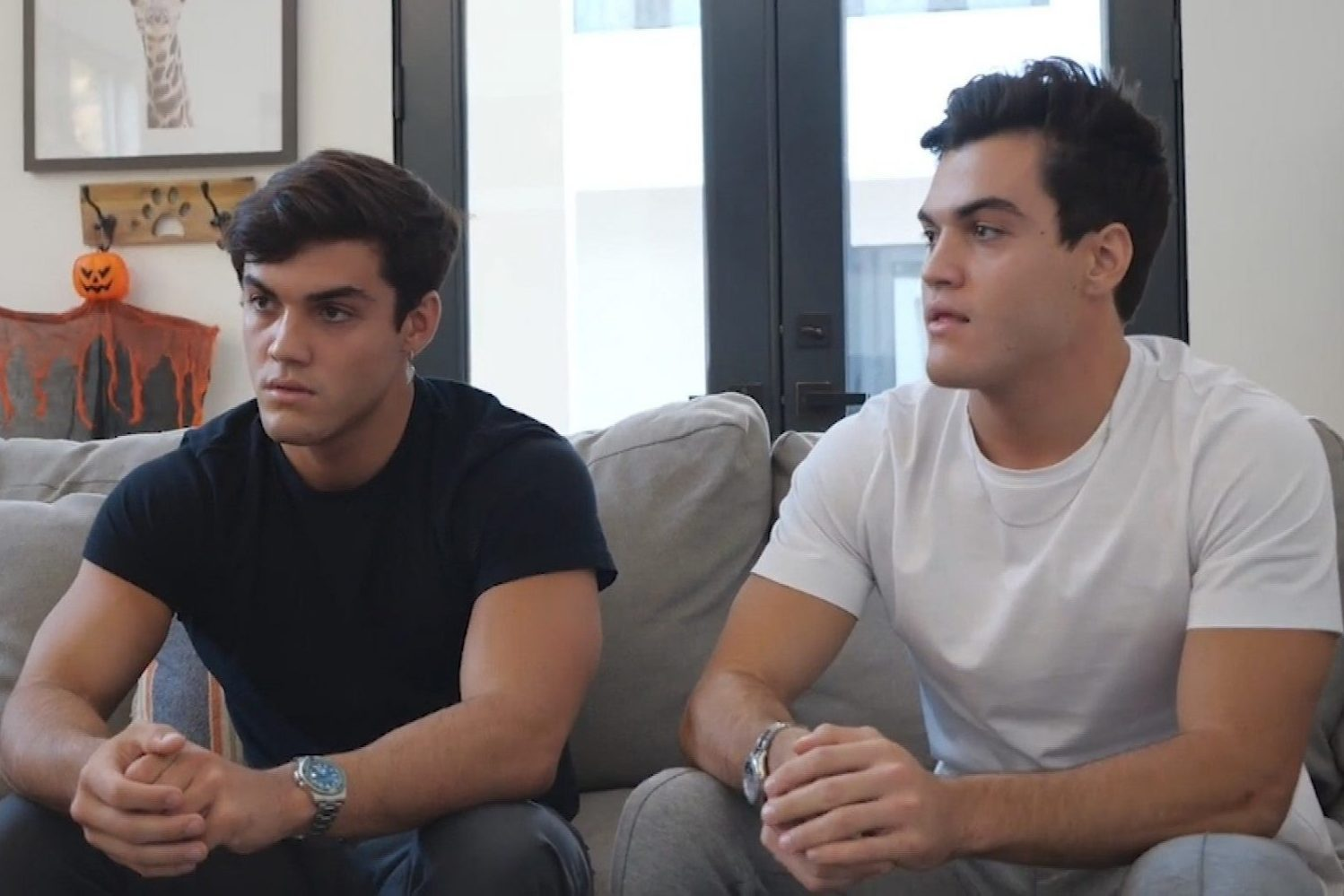 Image of the Dolan twins sitting on a couch