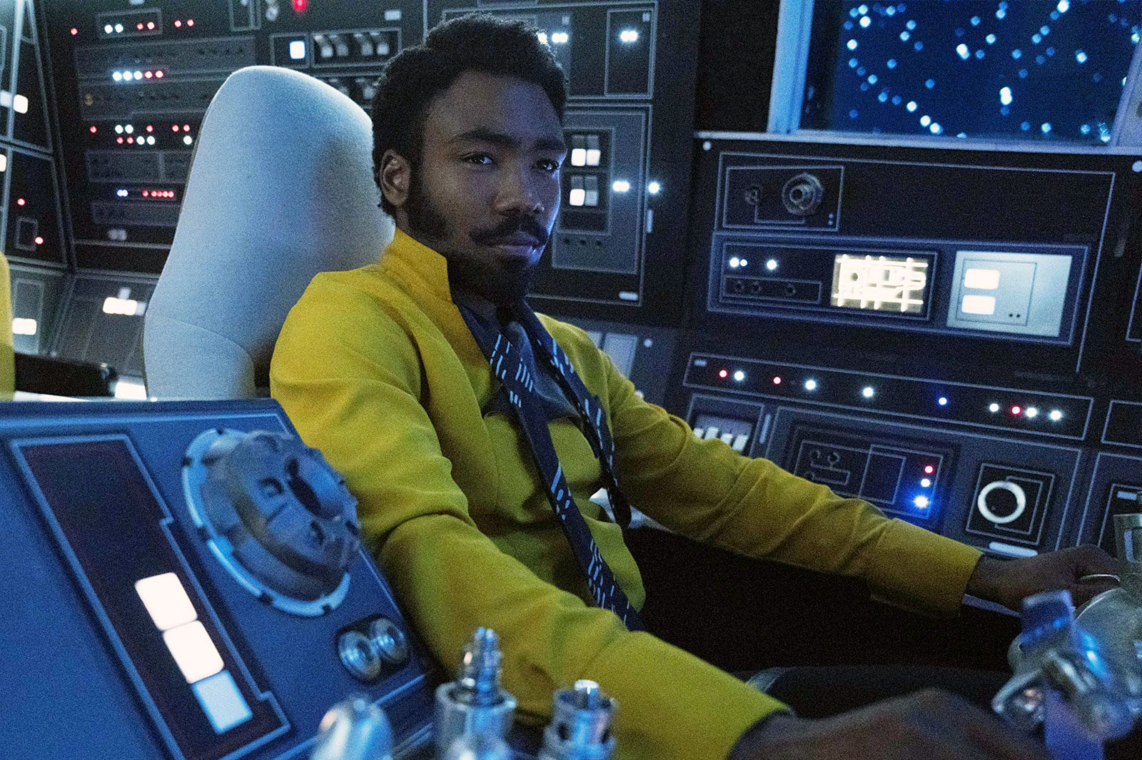 "Donald Glover as Lando Calrissian in a ship's cockpit in ""Solo: A Star Wars Story."""
