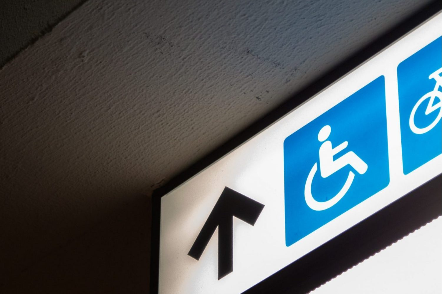 In article about disabled college students returning to campus, an image of an accessibility sign