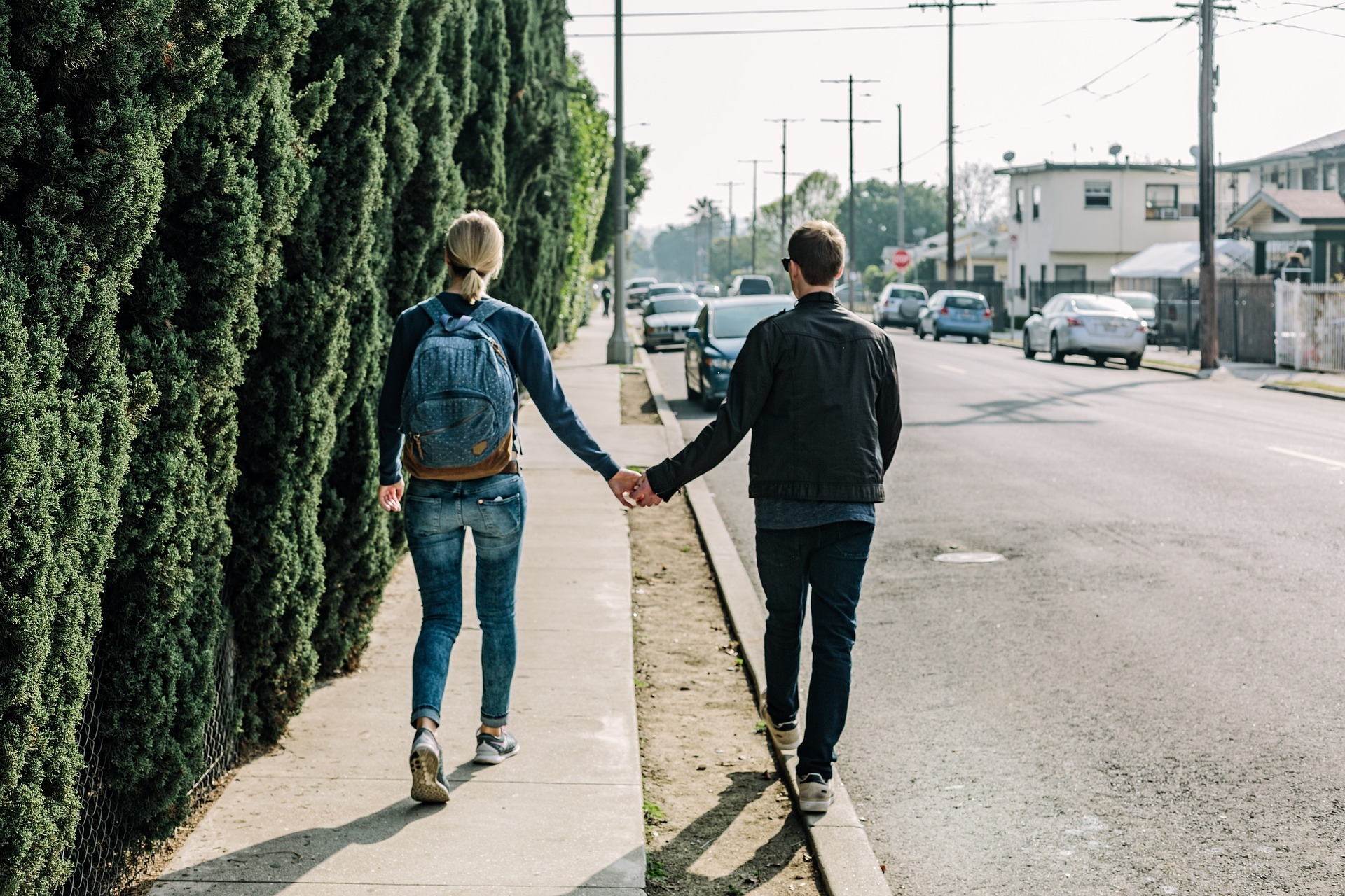 In an article about dating someone entering basic training, a couple holding hands in the street