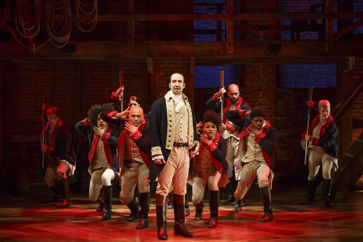 The cast of Hamilton on stage during a performance