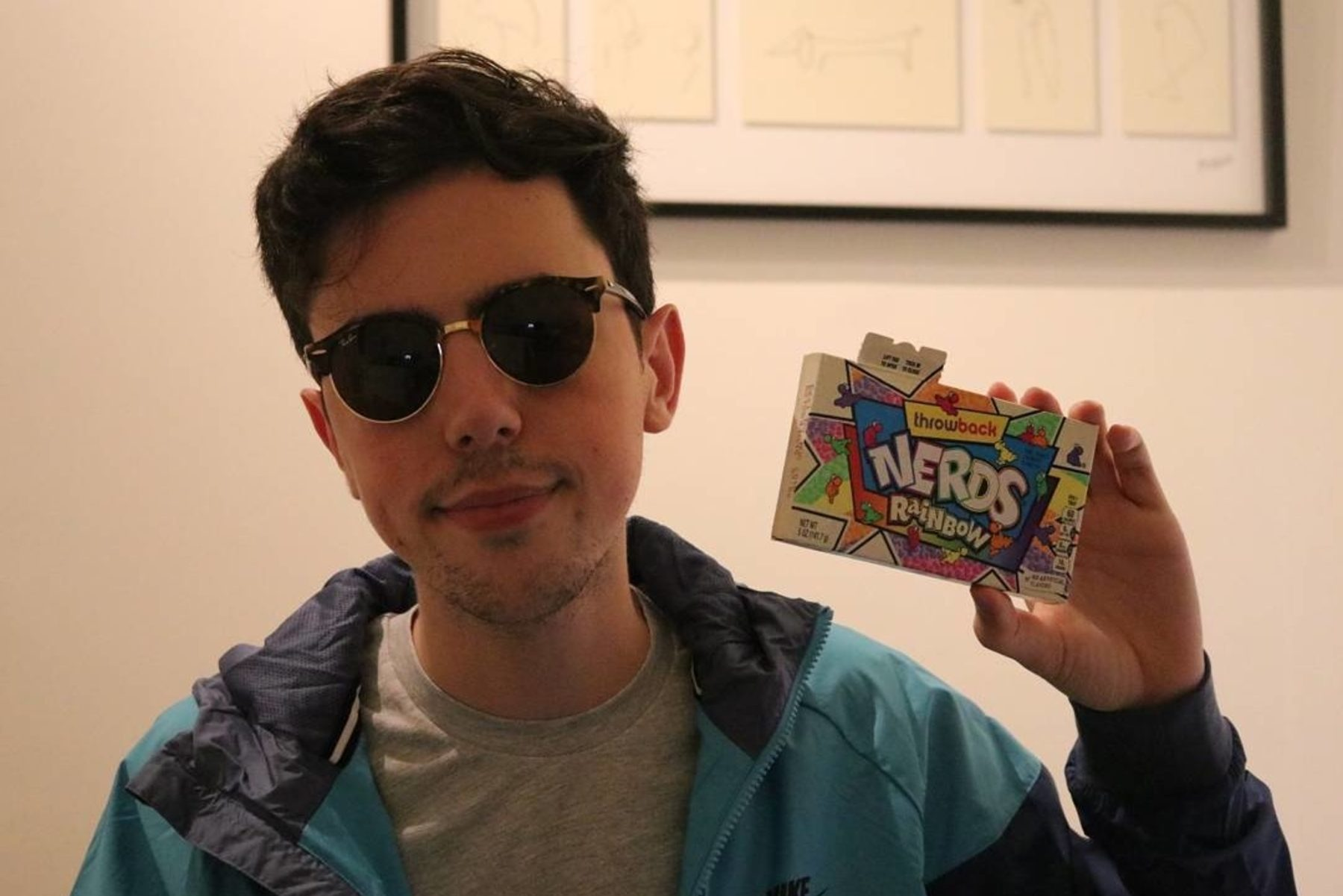 Mike from Mike's Mic holding a box of nerds