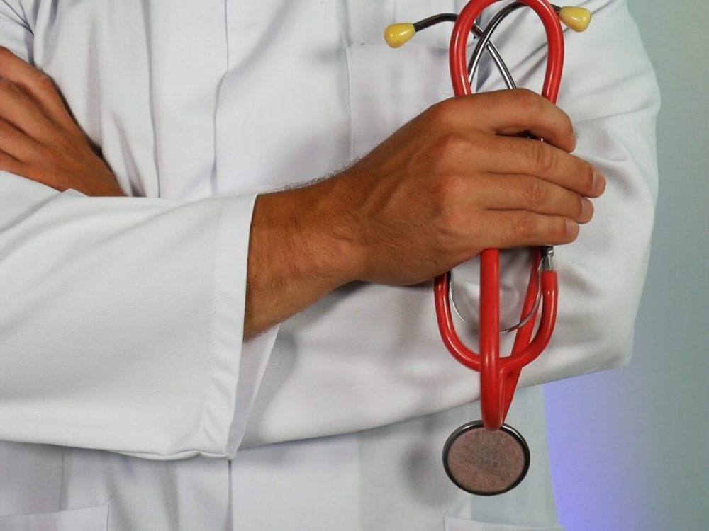 In an article about the coronavirus and living with parents in the medical profession, a photo of a doctor holding a stethoscope