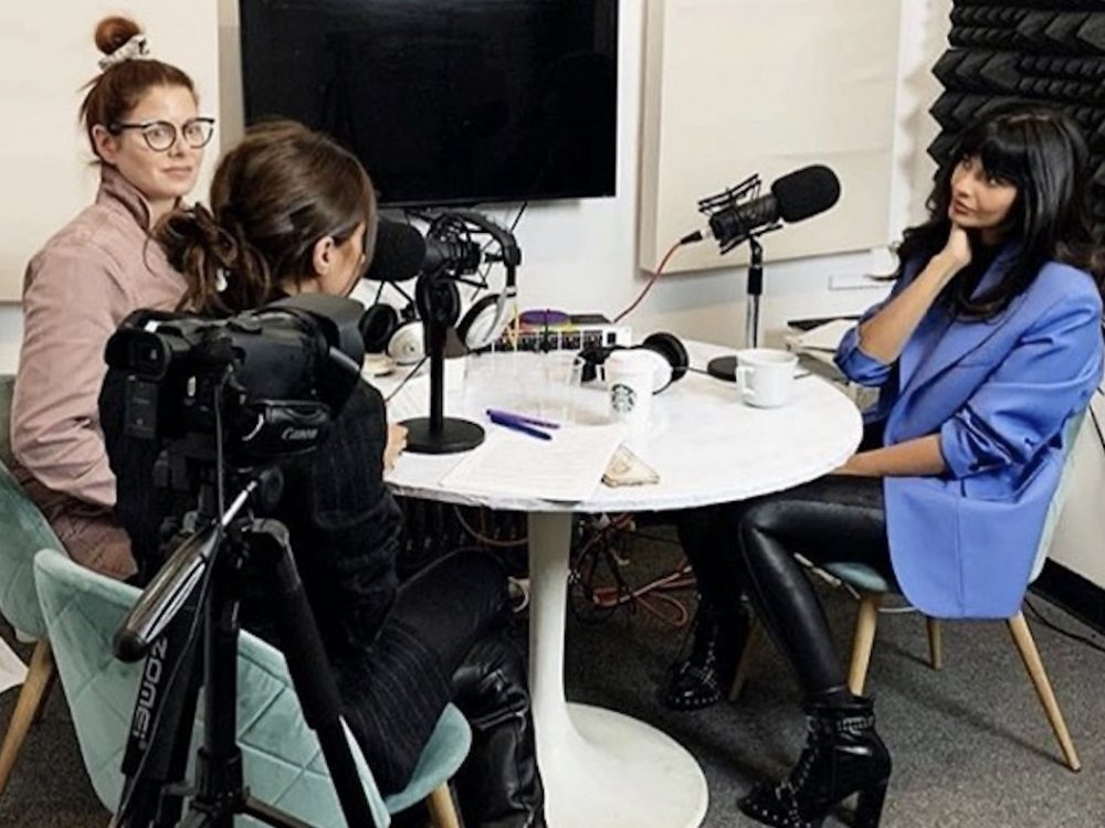 Image of Jameela Jamil hosting podcast I Weigh with Debra Messing