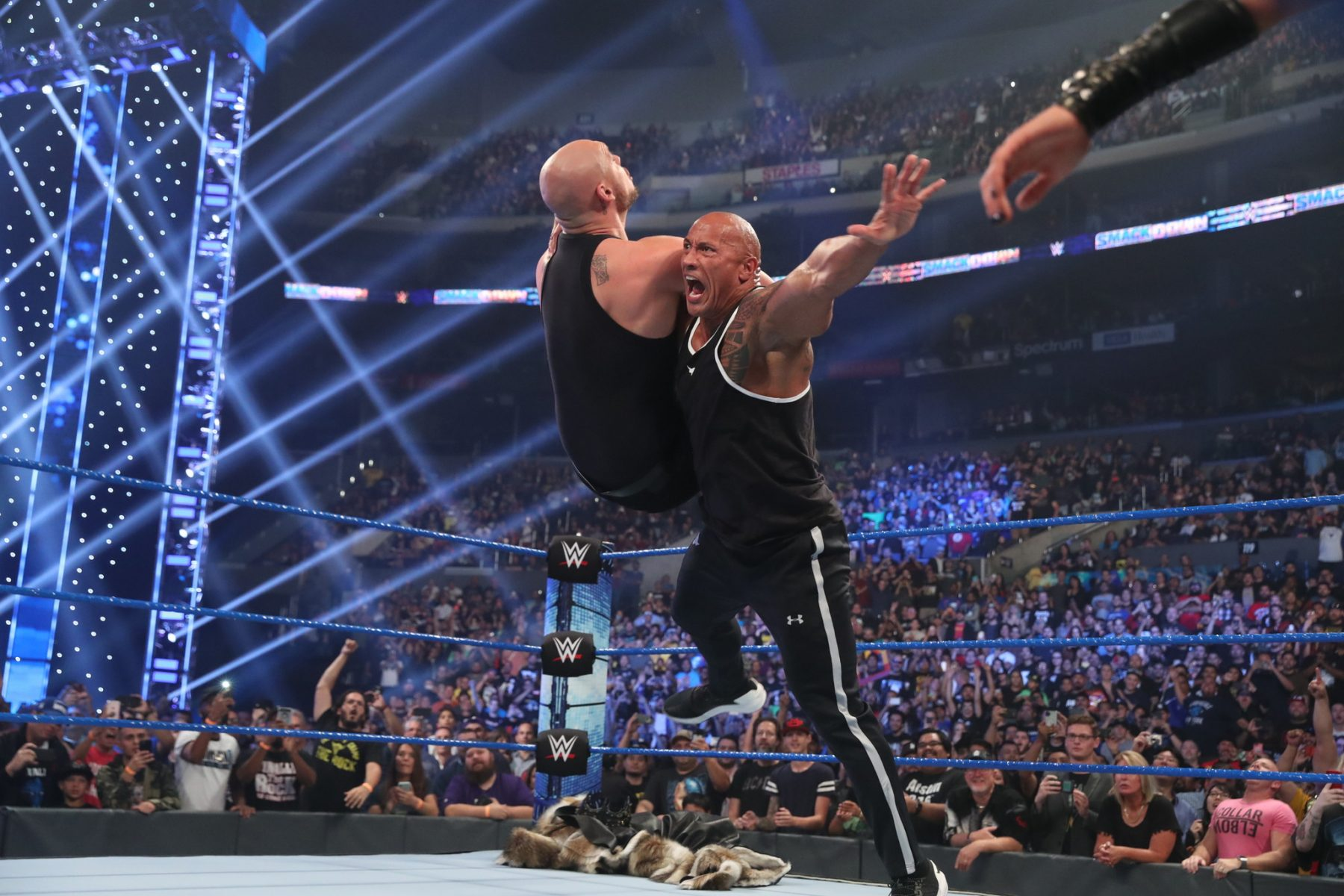 "Dwayne ""The Rock"" Johnson wrestling with someone in the WWE"