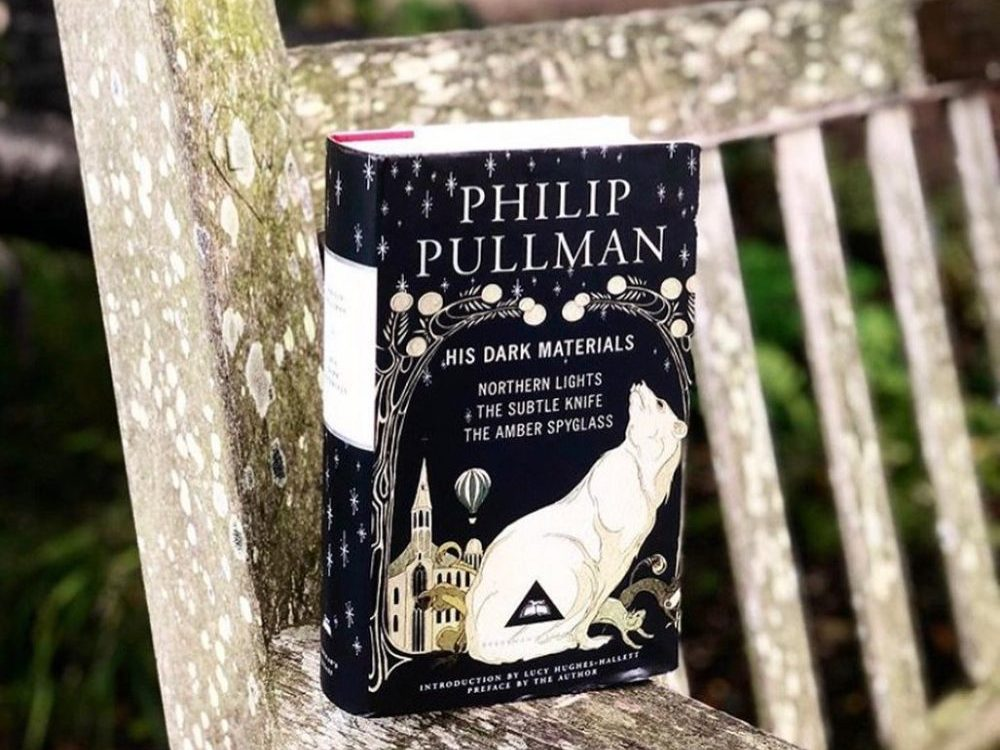 Photo of His Dark Materials collection on a wooden chair