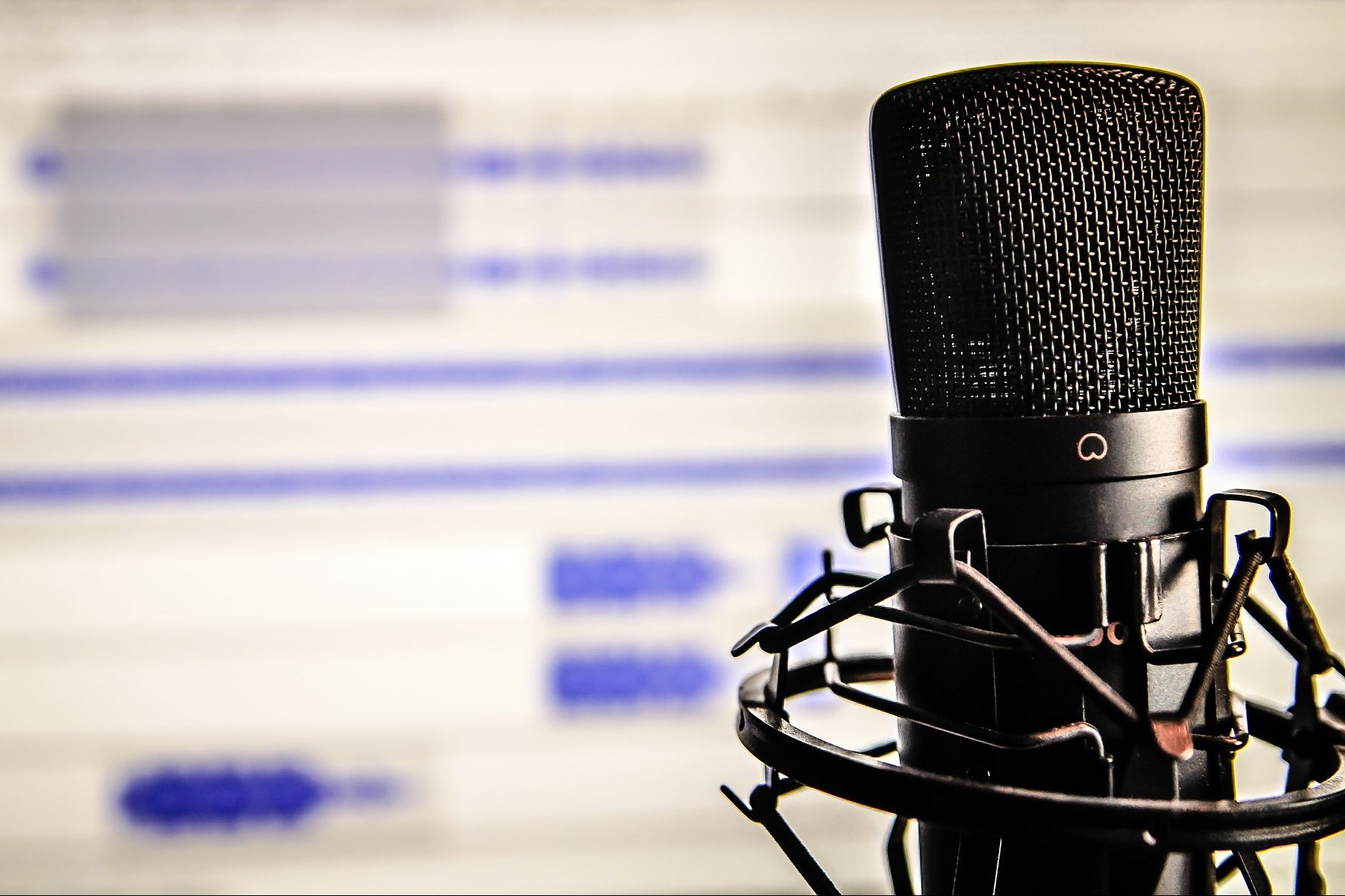 In an article about starting an actual play podcast, a microphone in front of a computer