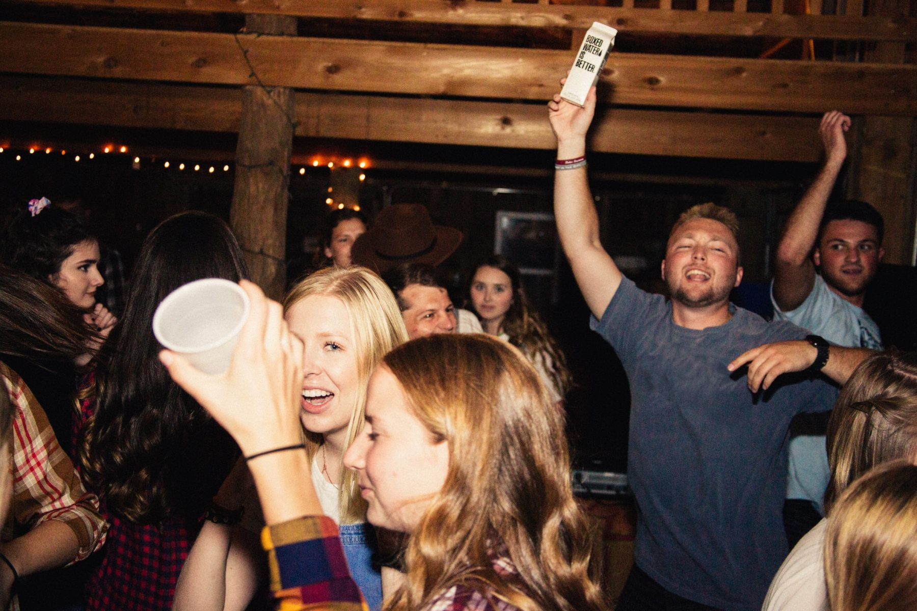 In an article about TikTok influencers, a photo of people at a house party