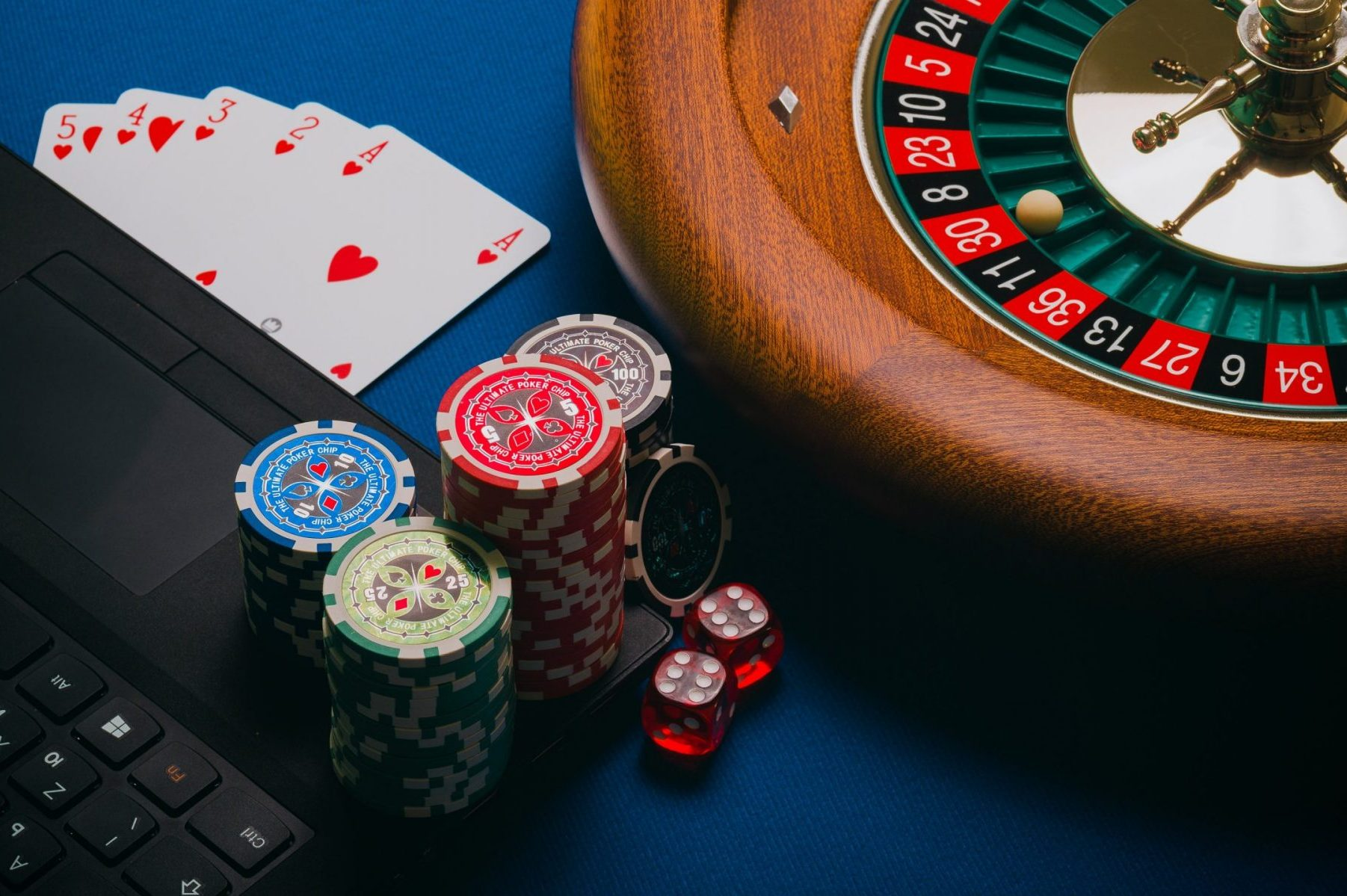 in an article about nice online casino games, a roulette wheel, playing cards and casino chips
