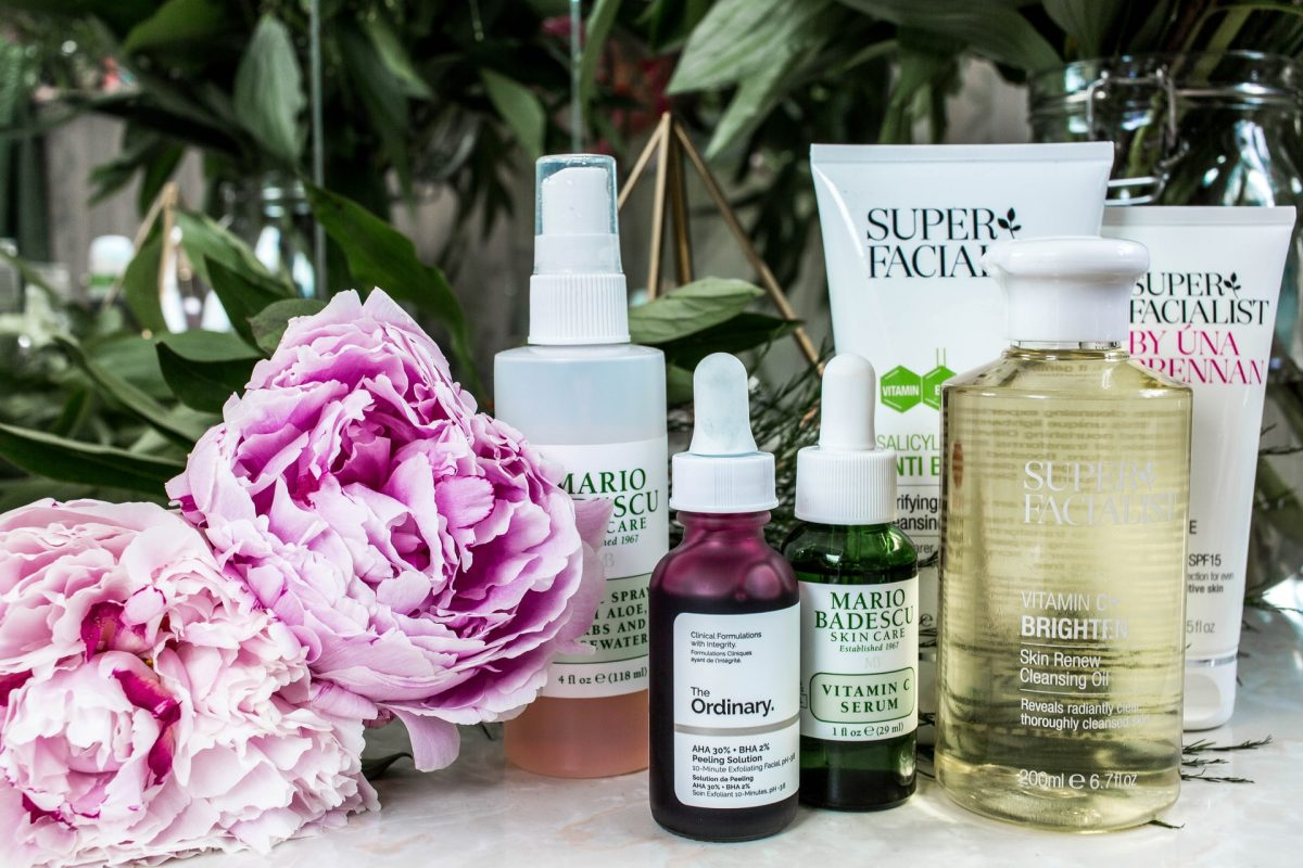 For an article about natural skincare, a photo of peonies next to various bottles of skincare products