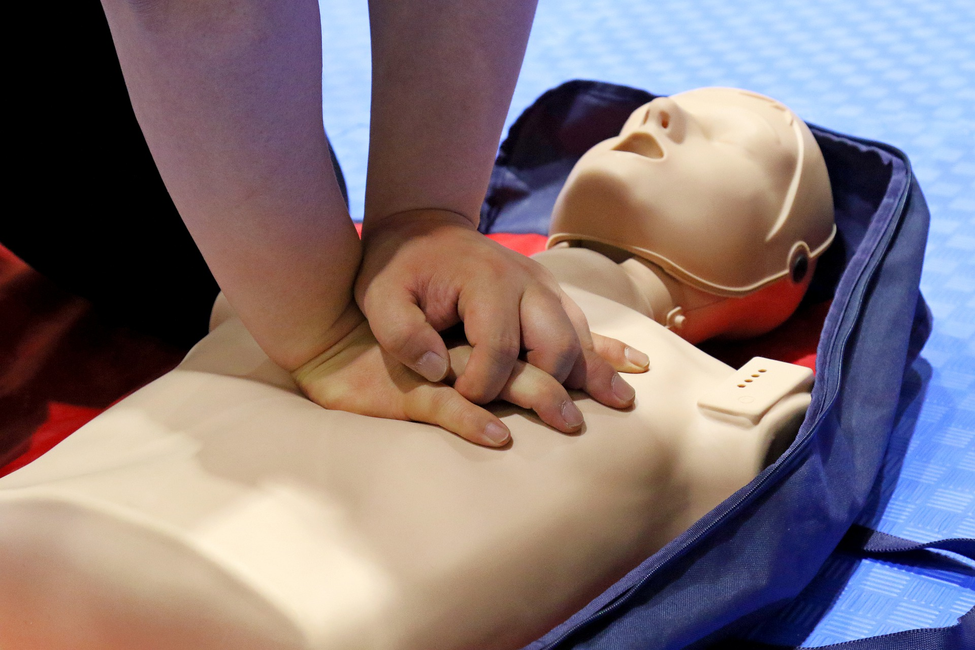 Image of someone performing CPR on a dummy