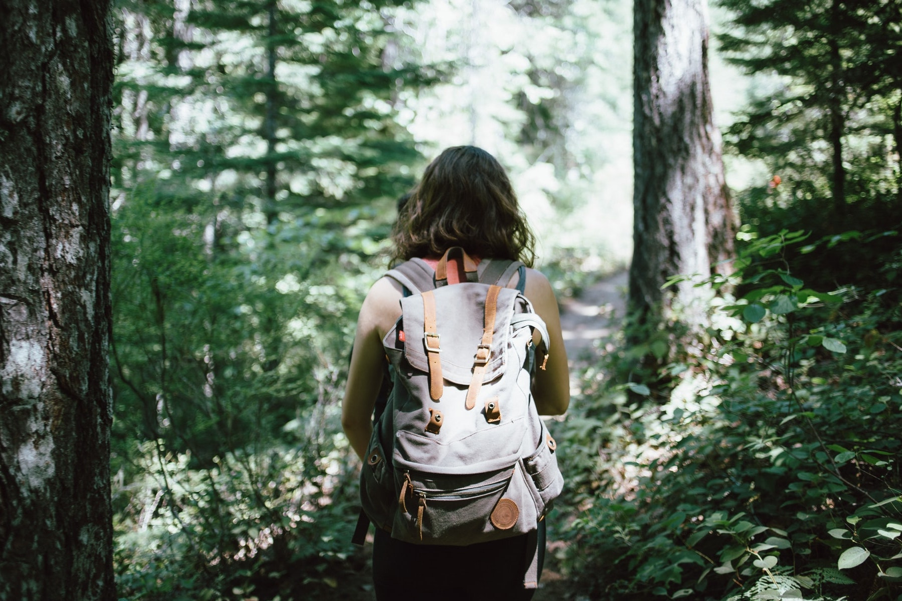 A photo of a woman hiking for an article about hiking trails in Georgia. (Photo by Jake Melara from Unsplash)