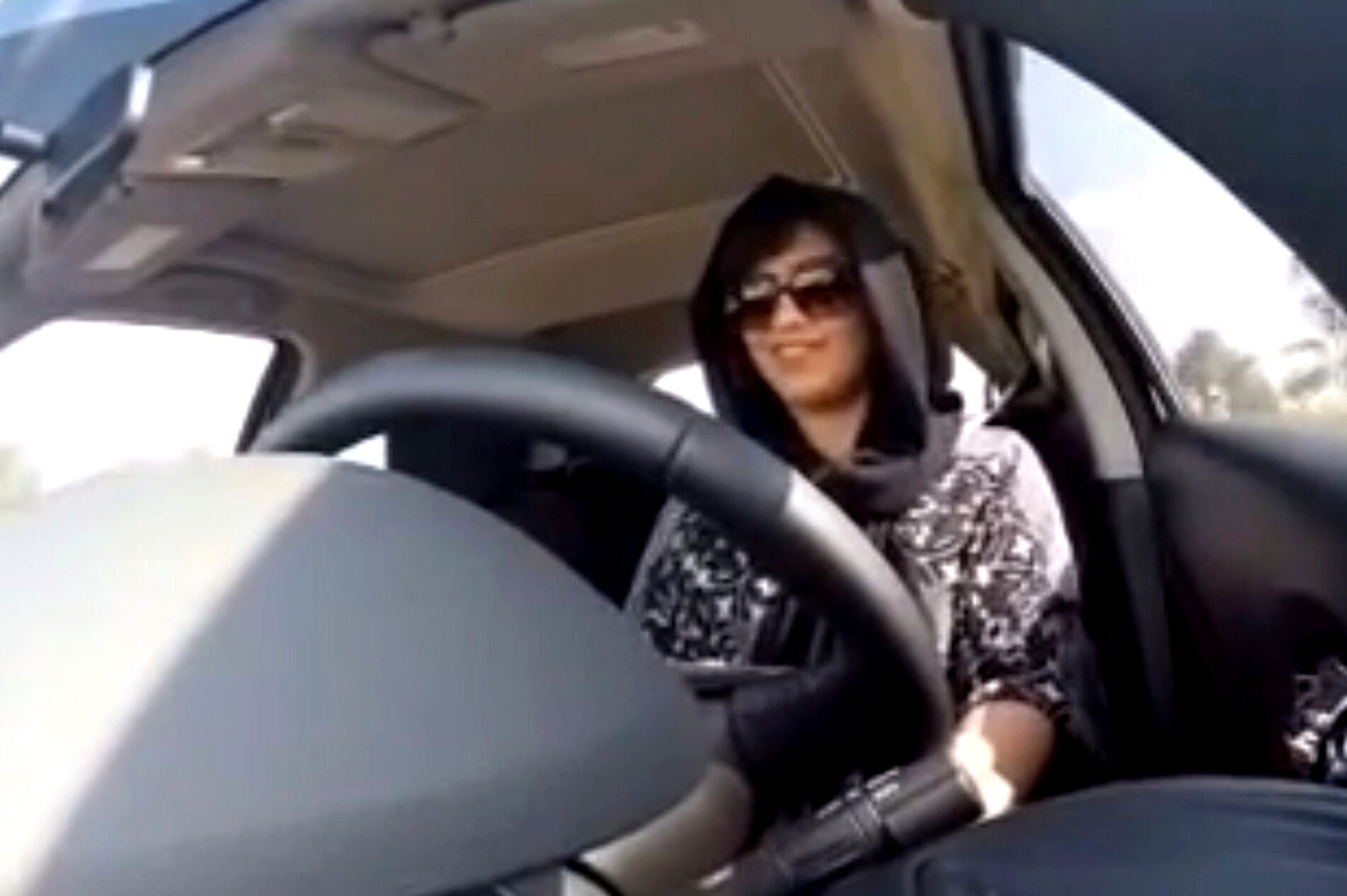 Loujain al-Hathloul filming a video of herself driving