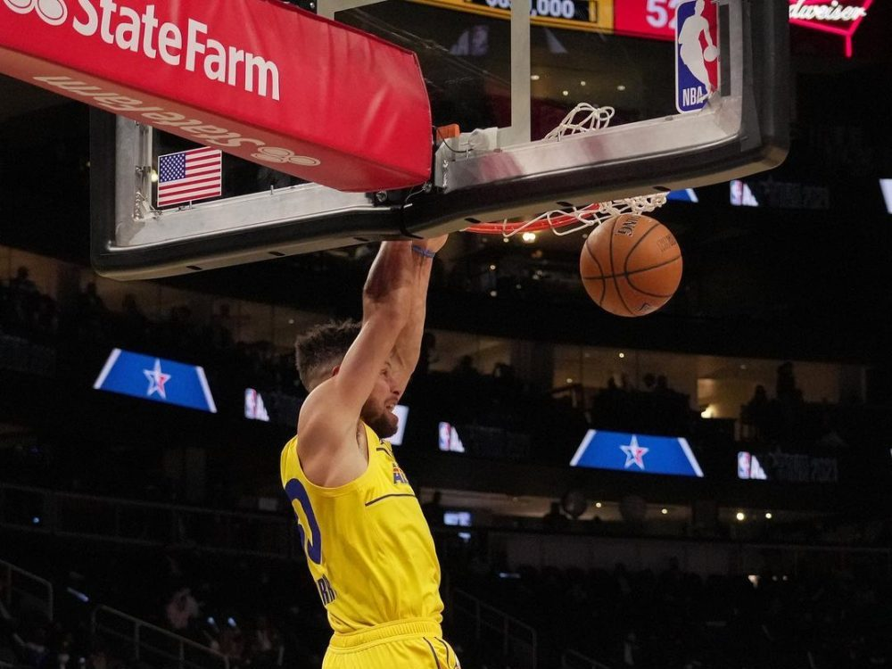 Steph Curry dunking in an article about NBA All-Star Weekend