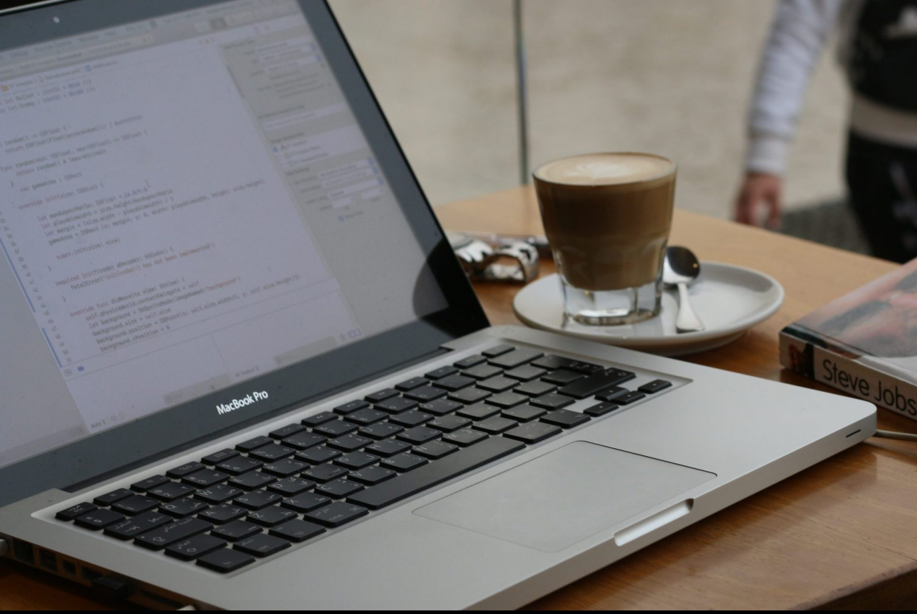 In an article about improving English grades, a computer with a cup of coffee next to it