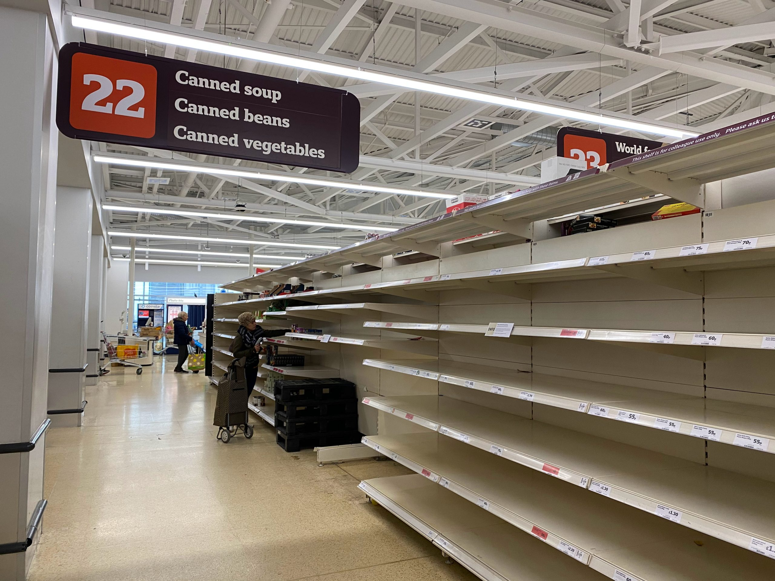 In an article about food inequality, empty grocery store shelves