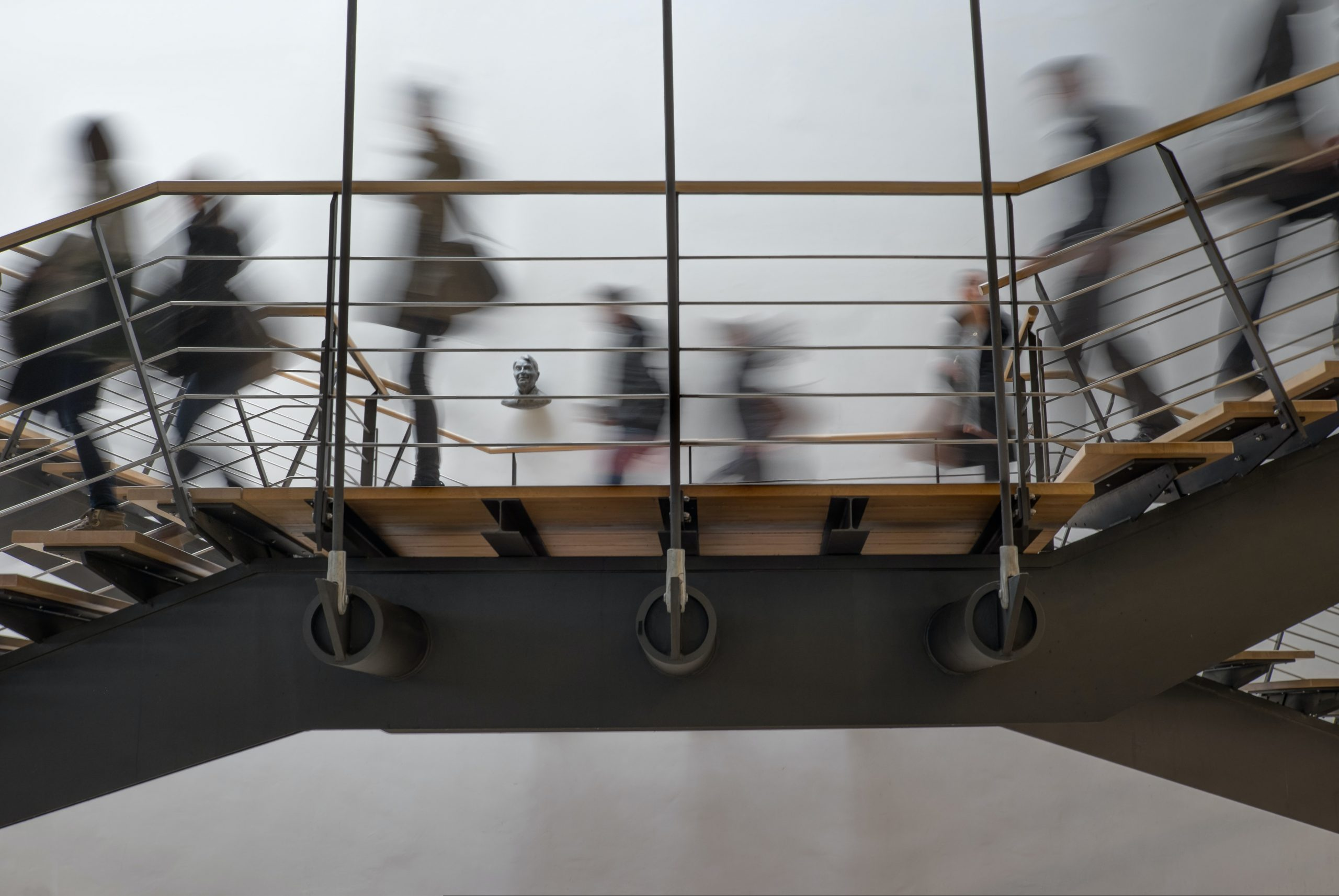 in article about seniors in college, a blurry photo of students walking on a walkway