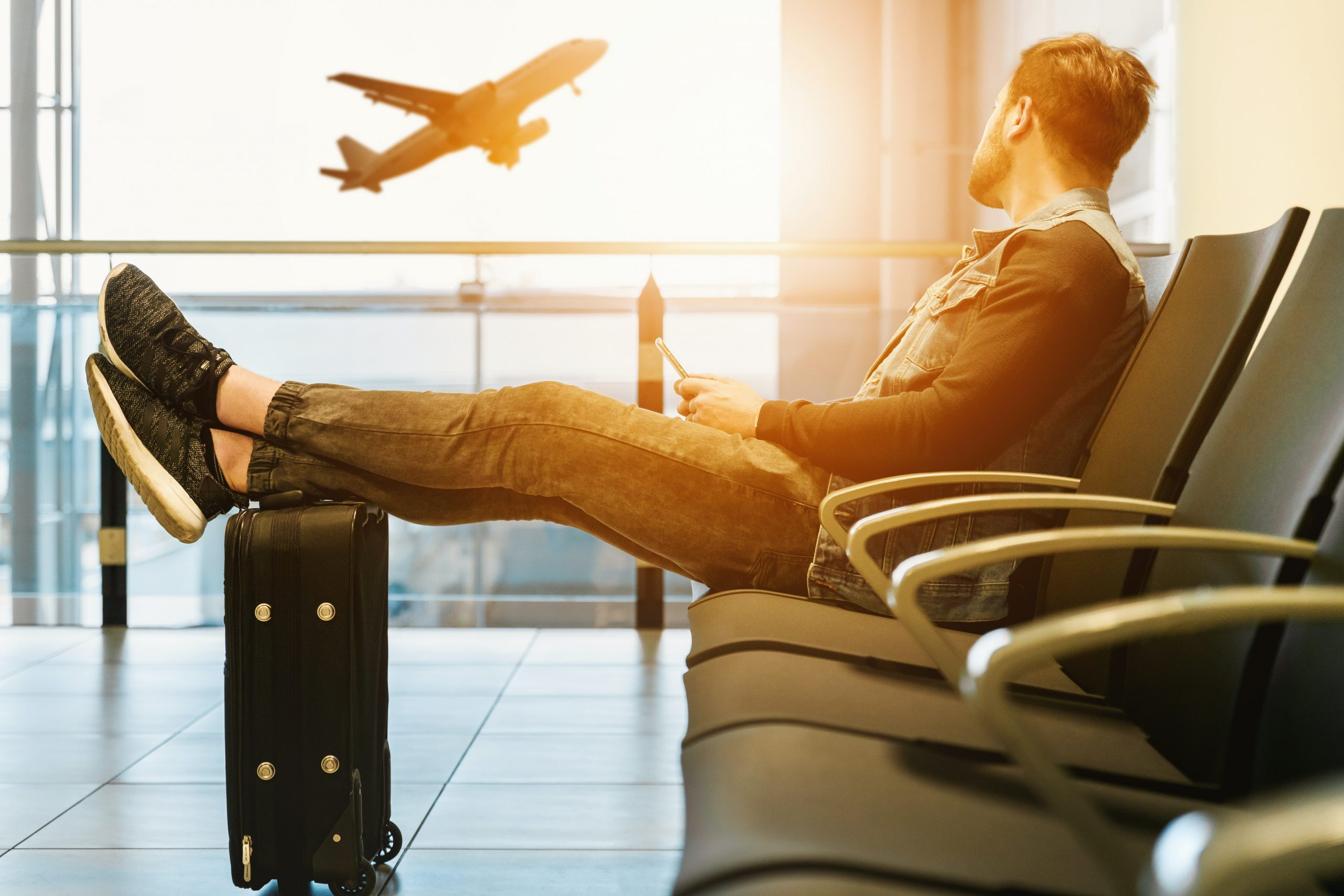 in article about getting a degree and travel, person in airport